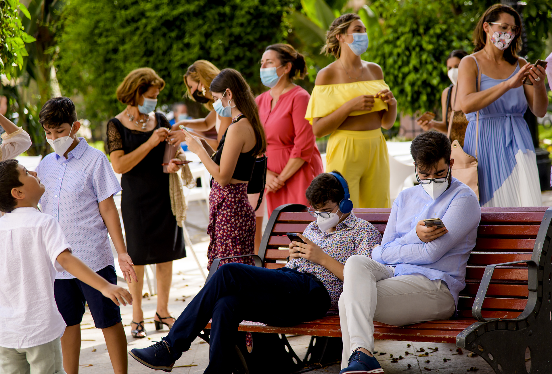 Aguilas COVID church wedding pictures | Family members, wearing masks in an effort to stop the spread of the virus