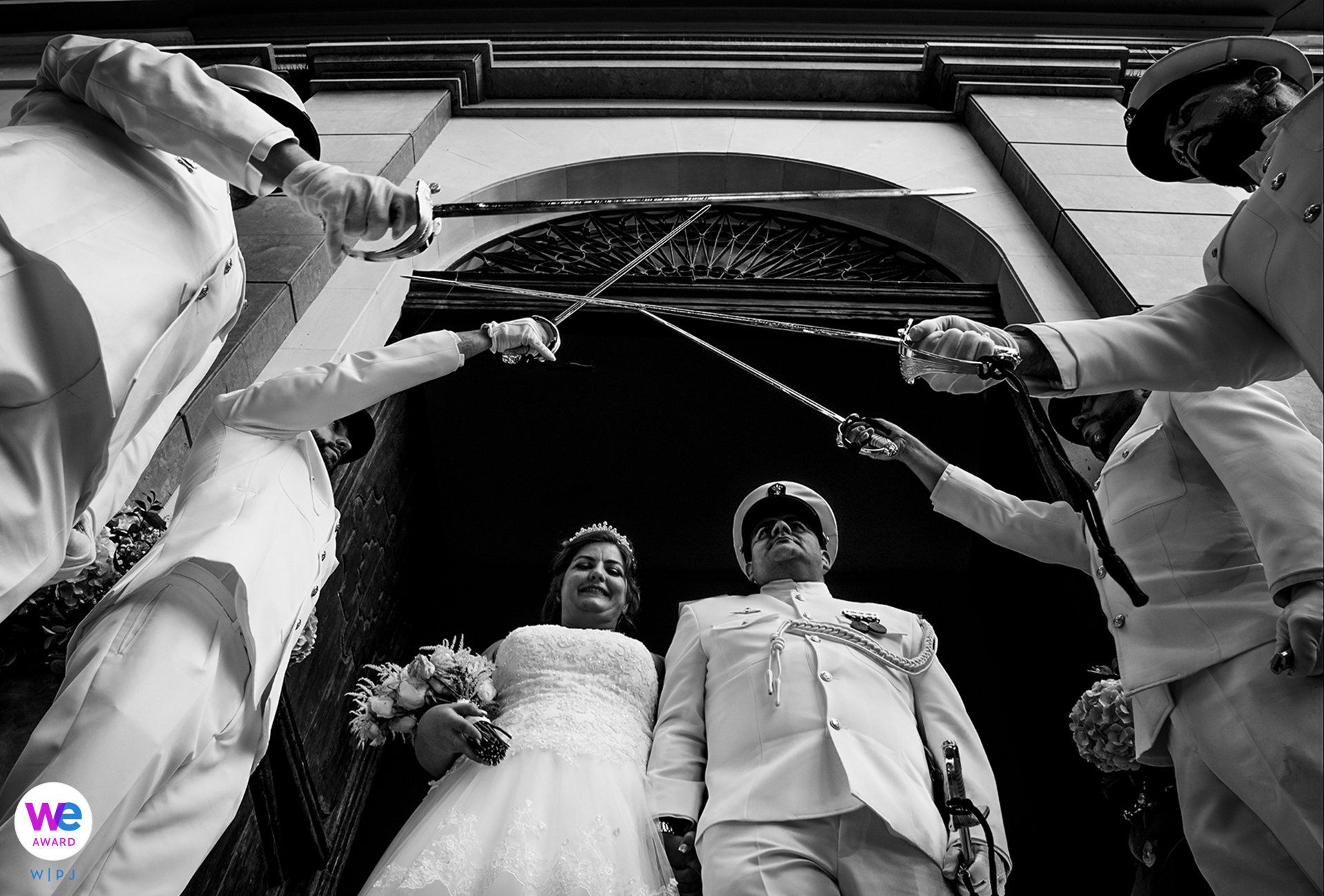 Aguilas, Spain Military Elopement Ceremony Photography | The couple makes a grand exit from the church under swords