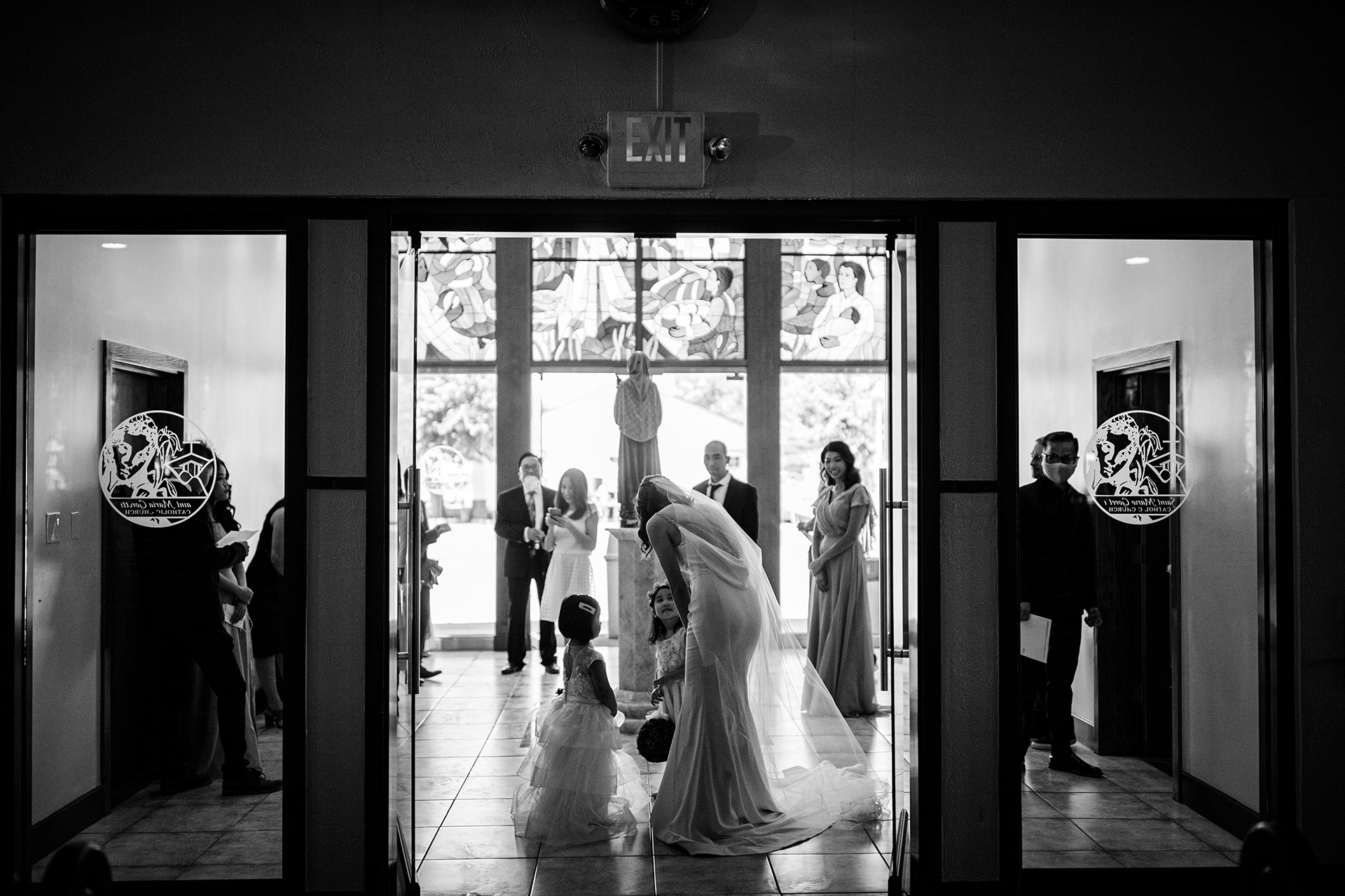 San Jose Catholic Church Elopement Photos | The bride talks with her excited flower girls