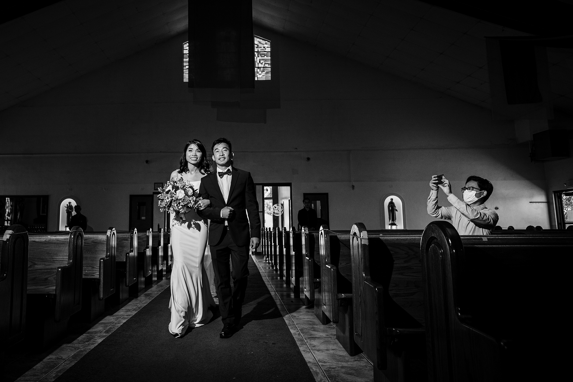 San Jose church wedding ceremony photography | The bride and groom walk down the aisle together