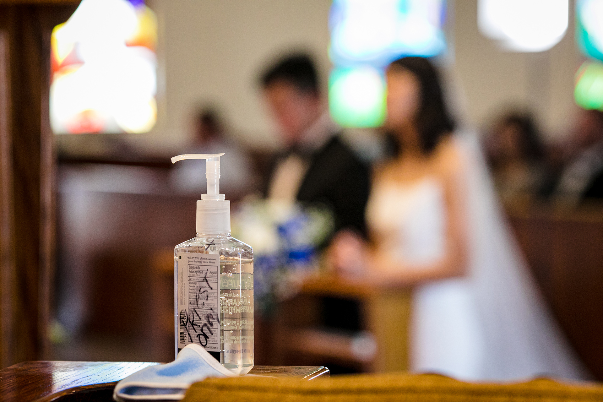San Jose COVID wedding pictures | This detail shot of the priest's personal hand sanitizer and face mask