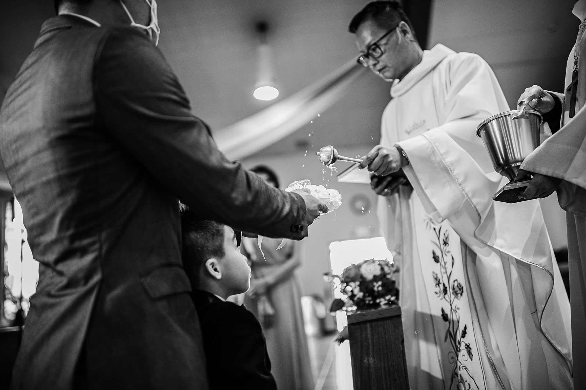 San Jose church COVID wedding images | The ring bearer watches in awe as the wedding rings are blessed