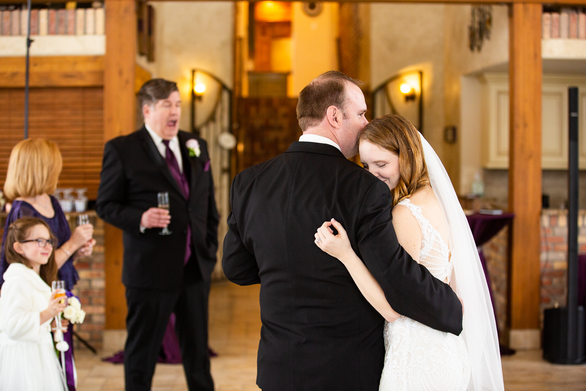 Estes Park Small Wedding Winter Pictures | the couple embrace during his best man's toast