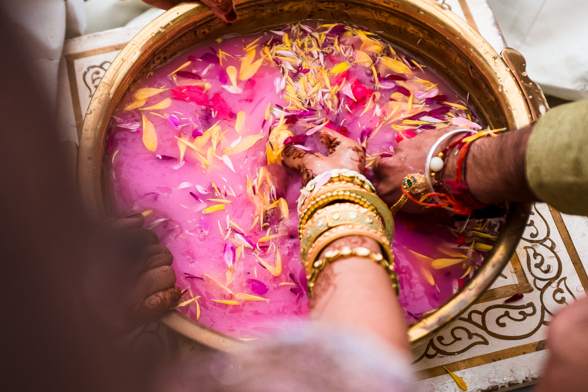 Indian Elopement Photographer for London UK | the bride or groom's wedding band is placed in a bowl filled with rose milk