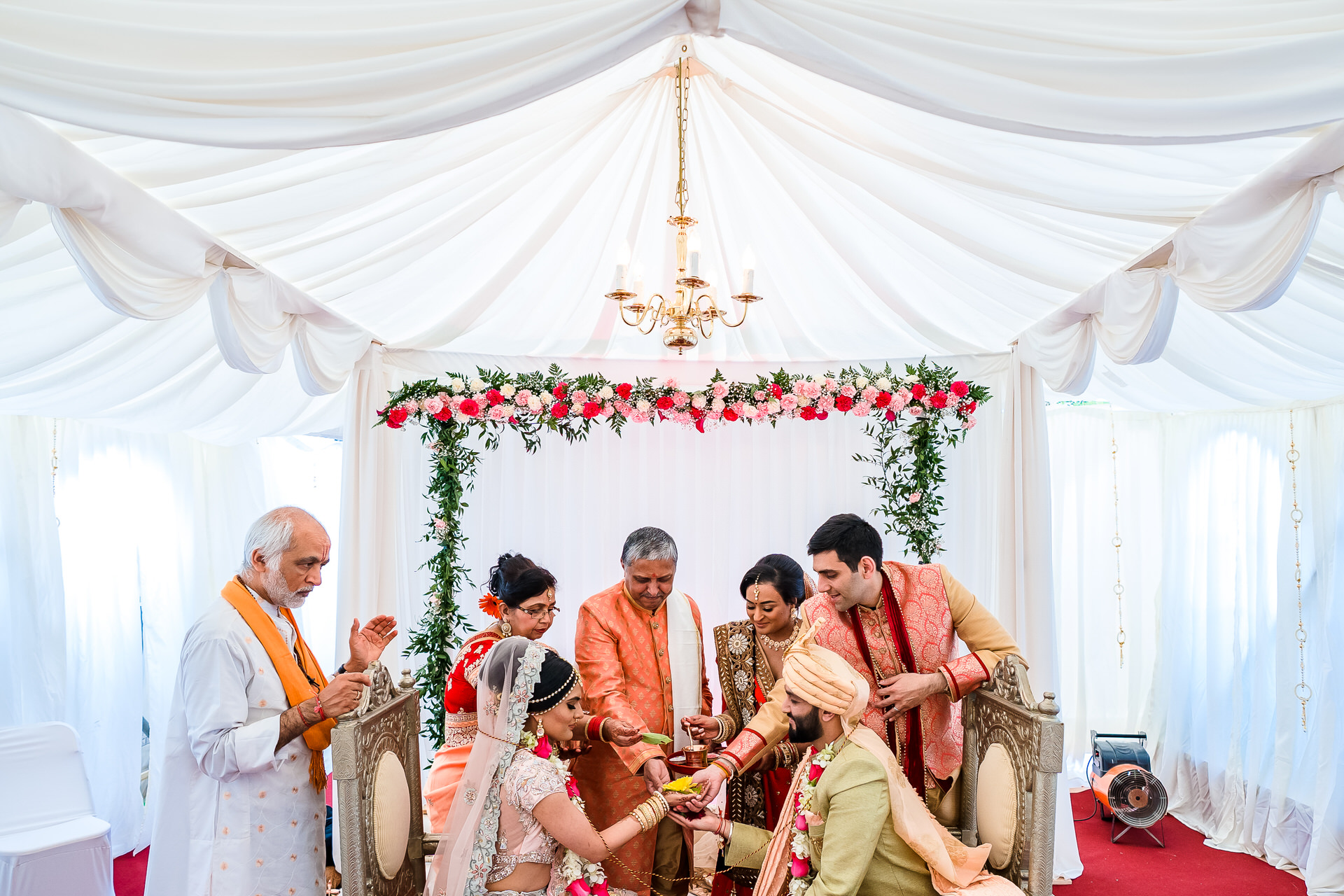 Top Asian Elopement Photography London - Indian Wedding | During Kanyadaan, the bride's father takes his daughter's hand