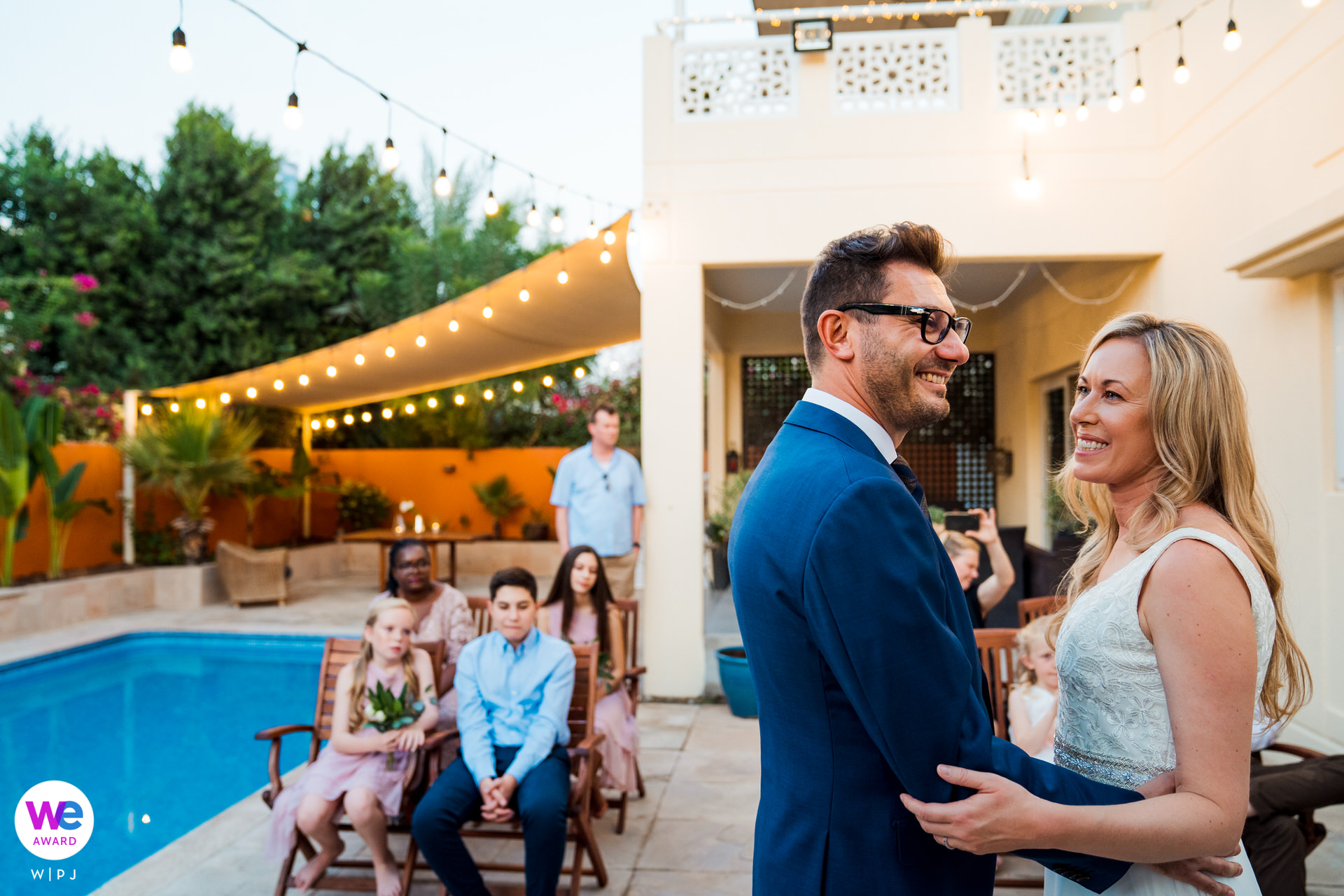 Backyard Villa - Dubai, UAE Elopement Photos | The bride and groom laughing at a joke shared by the wedding celebrant