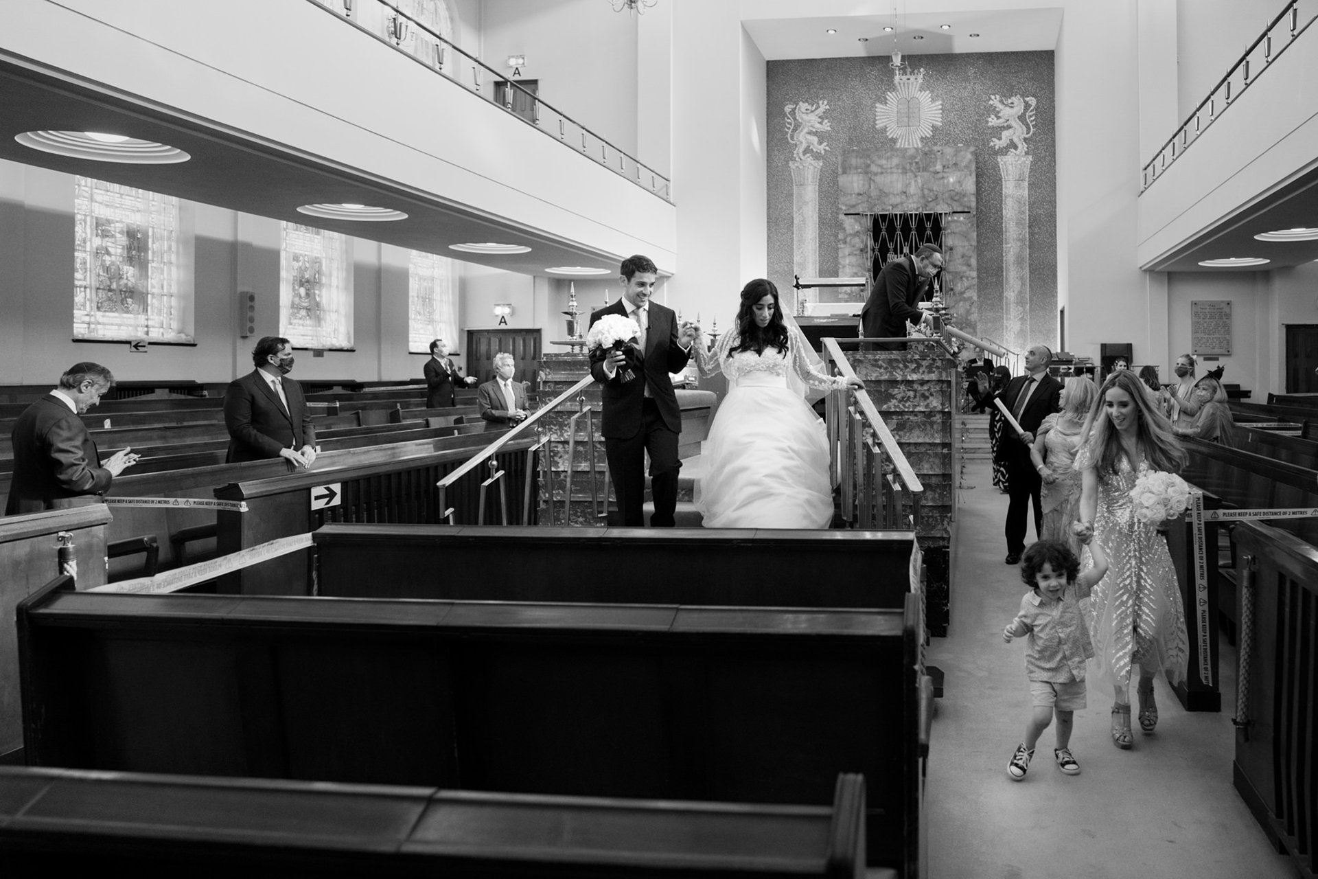 Elopement Photographer for the Central Synagogue, UK | The ceremony has concluded and the bride and groom begin their exit