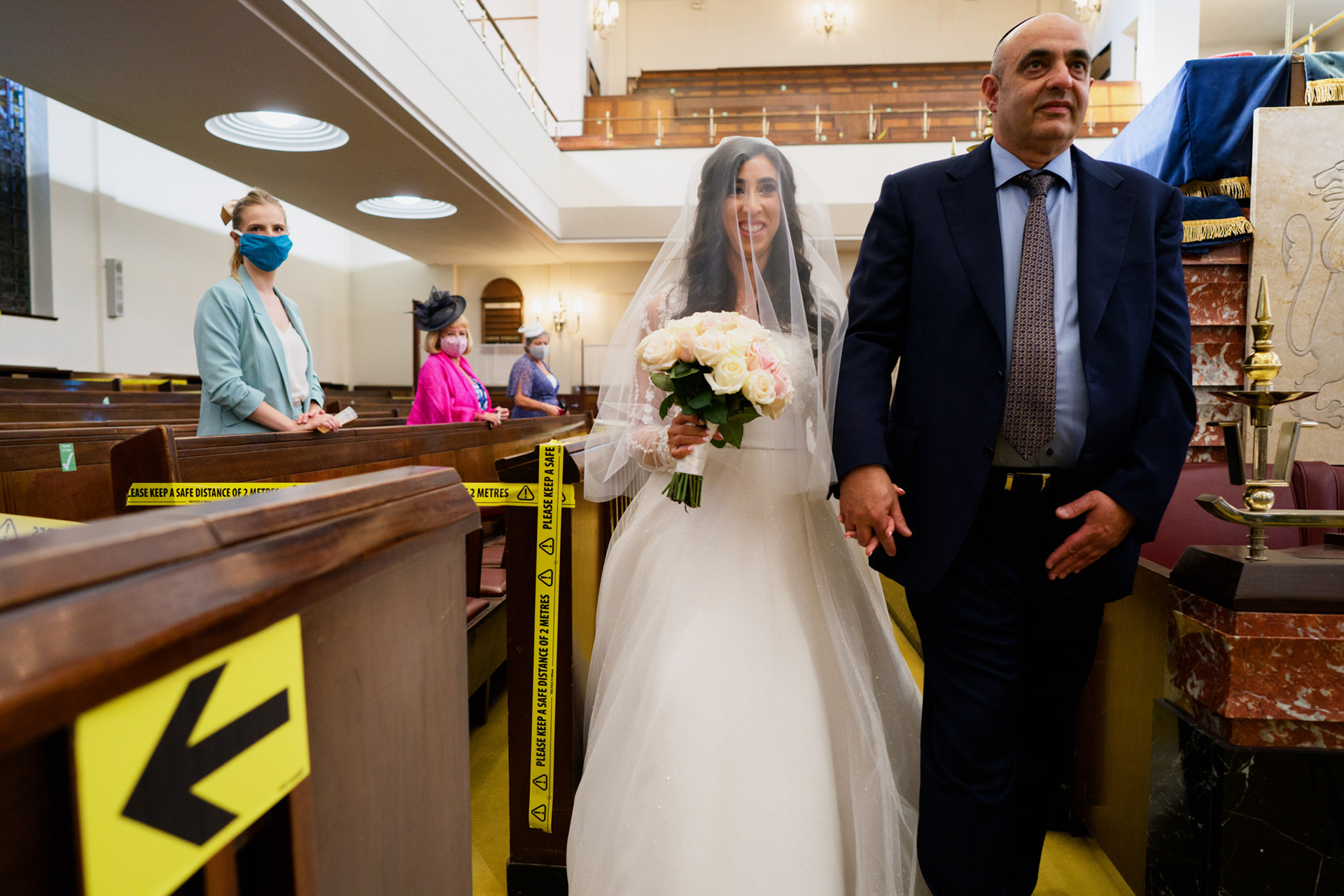 JCR-UK: Central Synagogue, Great Portland Street Elopement Photo | The bride and her father enter the synagogue