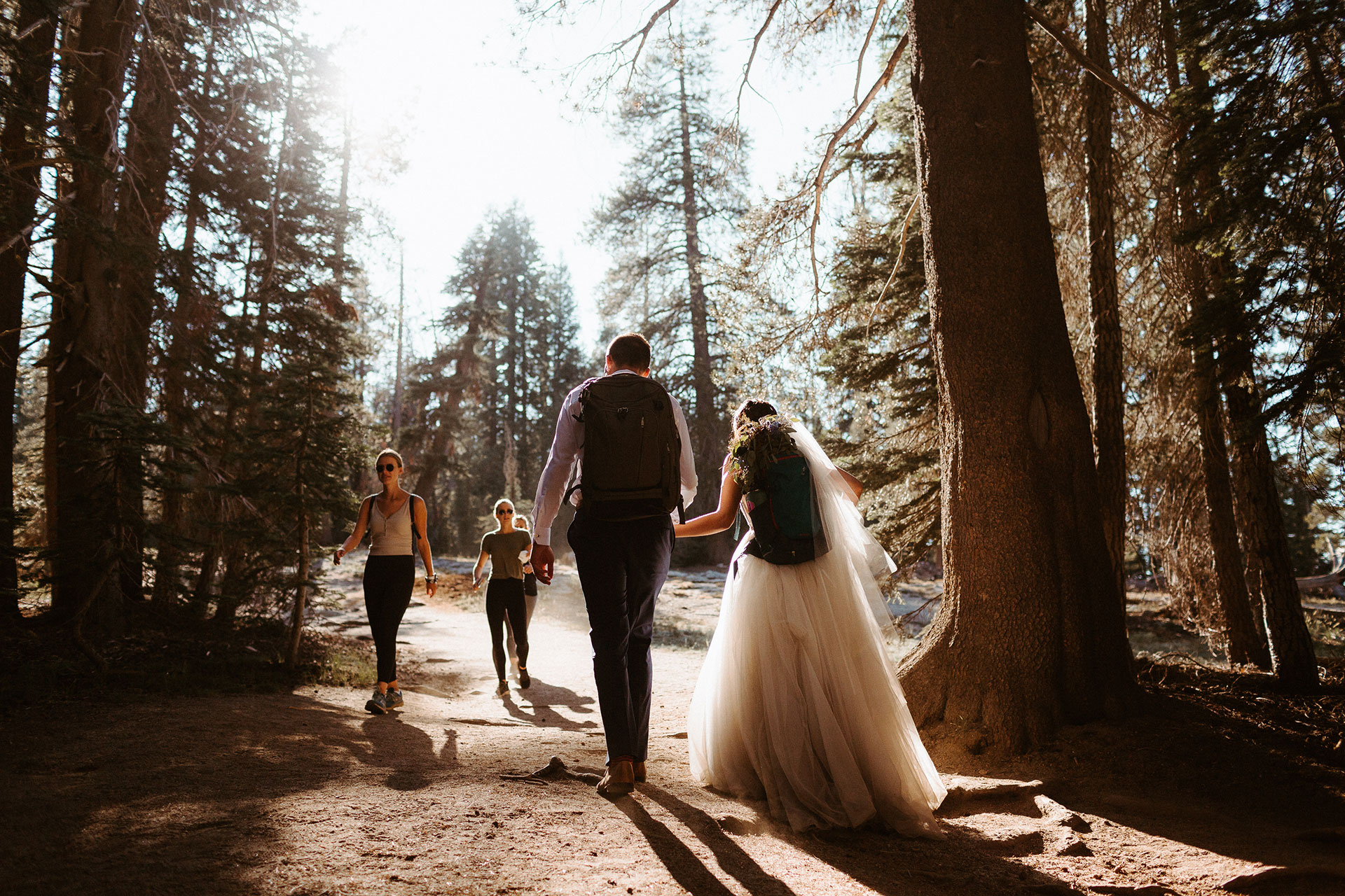 Yosemite National Park Elopement Photography   The bride and groom set off for Taft point