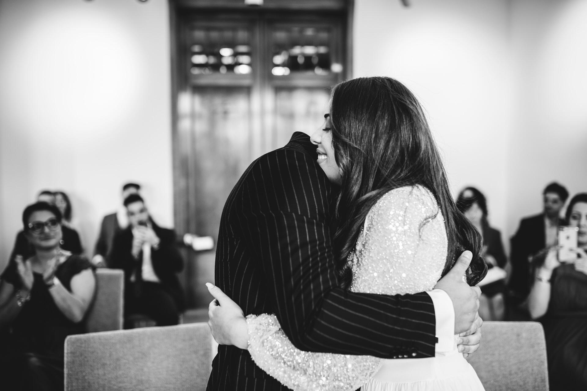 Wollishofen Port, Seestrasse Villa, Zürich, Switzerland Elopement Photo | The bride and groom embrace tenderly in a ceremony hug