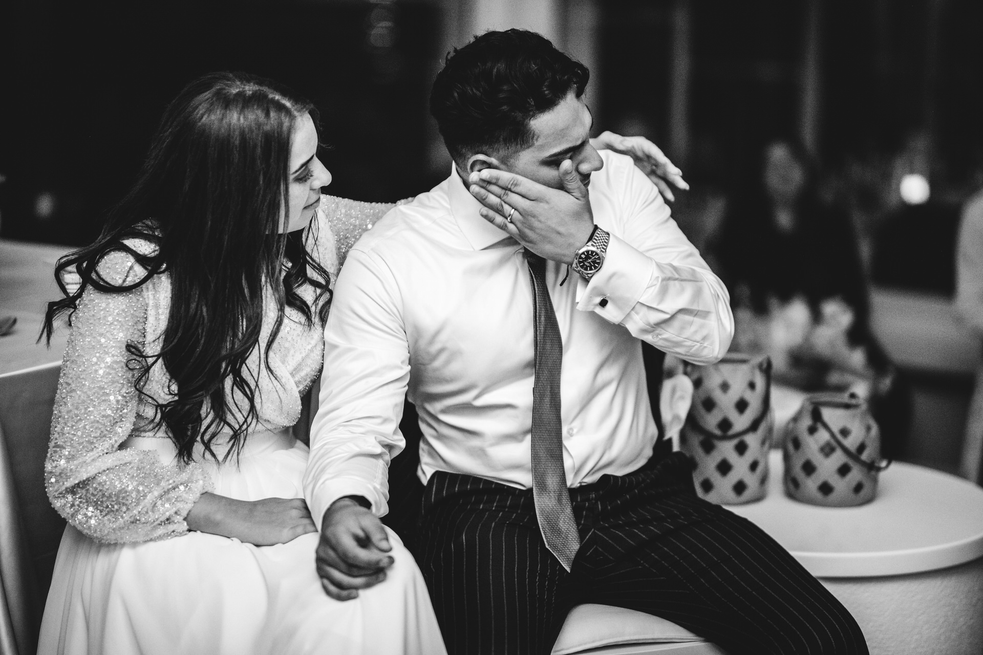 Zürich Elopement Venue Image | The bride and groom sit next to each other during the reception party
