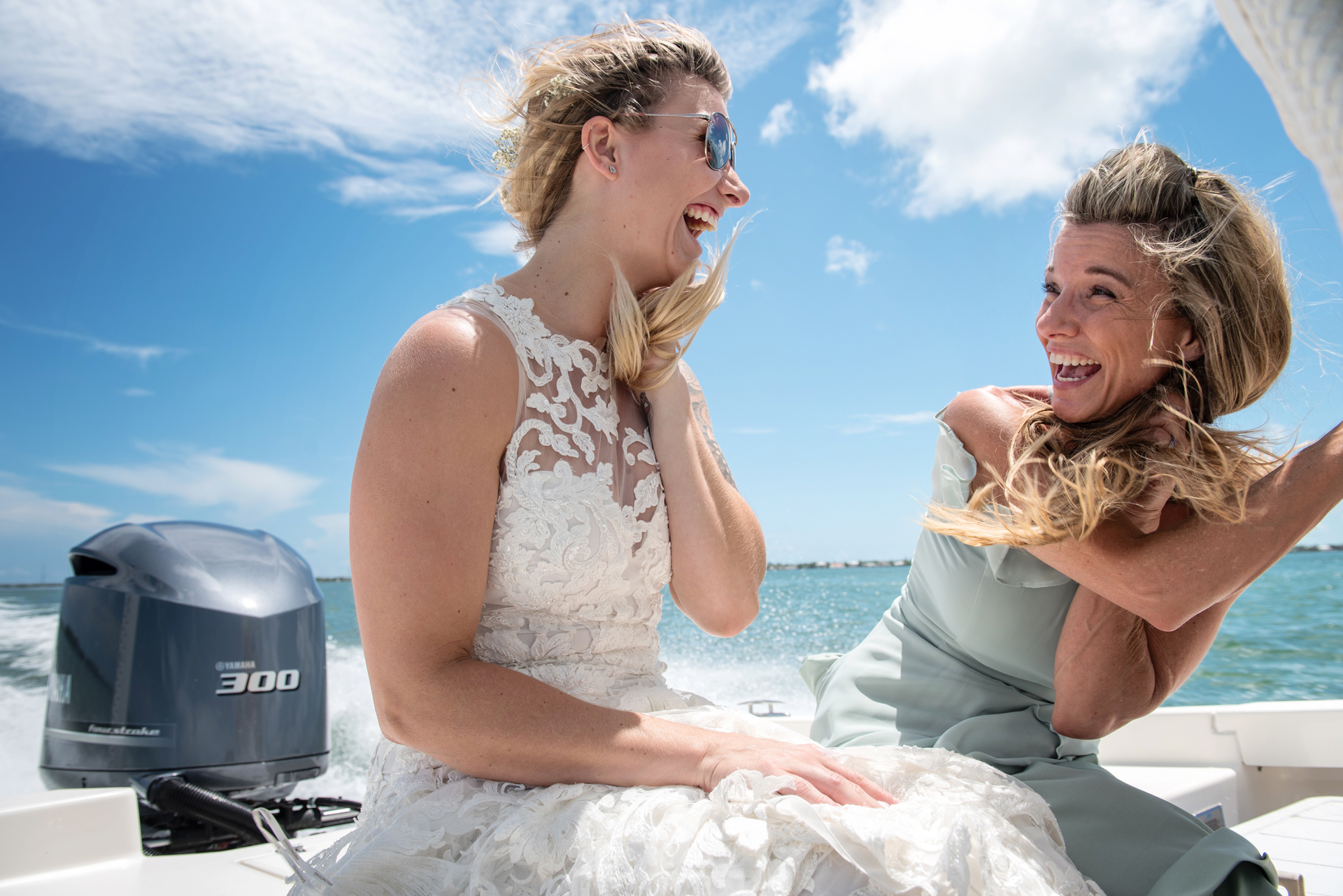 Elopement Photography for Florida Keys | The bride and MOB are having a blast on their boat ride out to the ceremony location