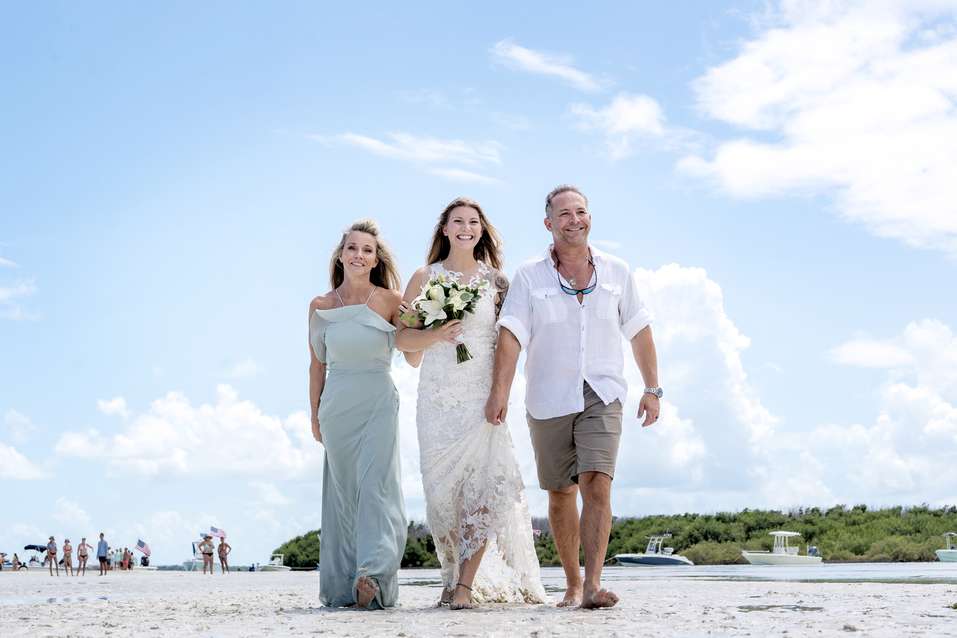 Key West Elopement Photographer | Amber's parents escort her down the aisle for this sandbar wedding