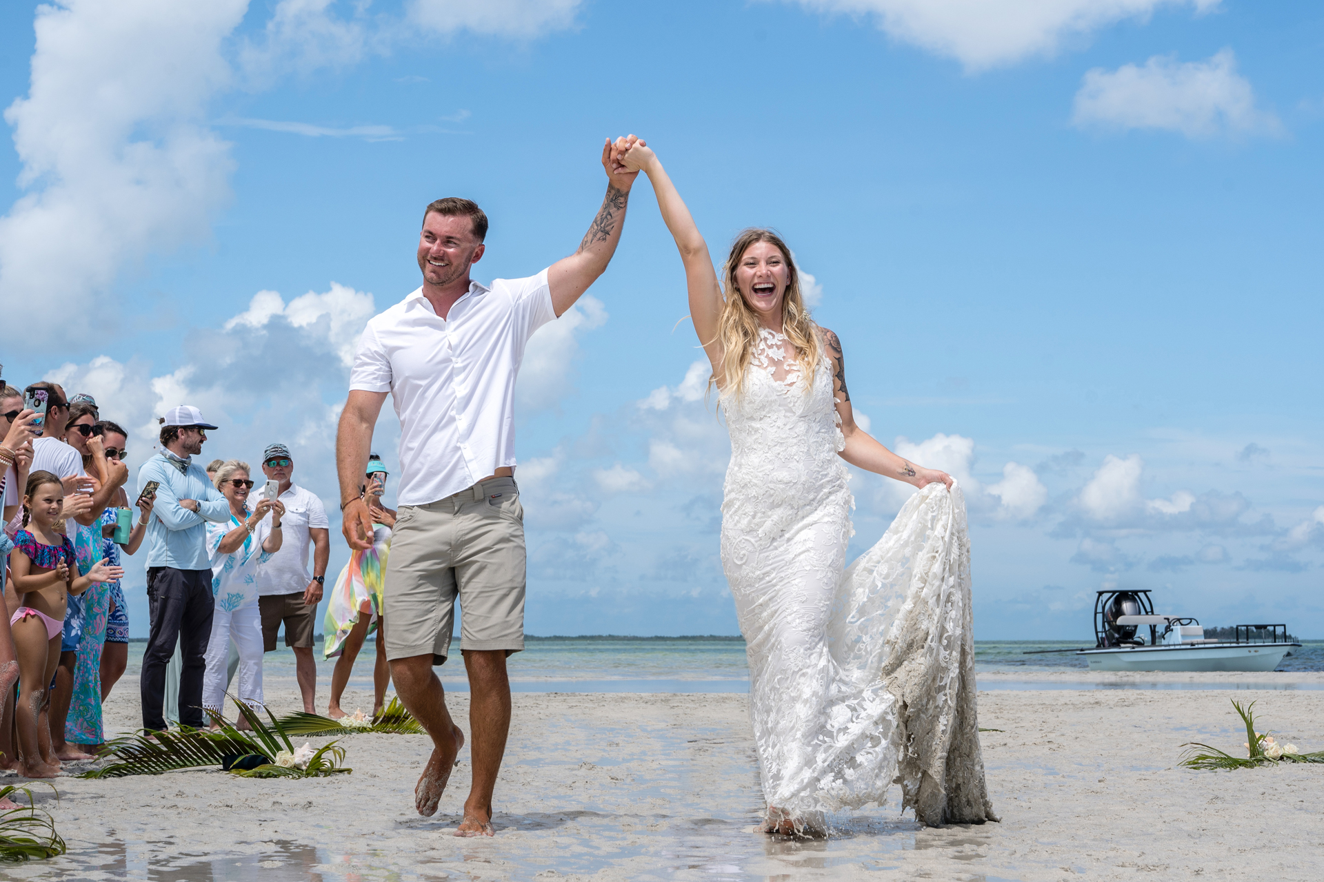 Florida Wedding Photography, Key West Elopements | The couple is shocked by how many beach bystanders came to give their congratulations