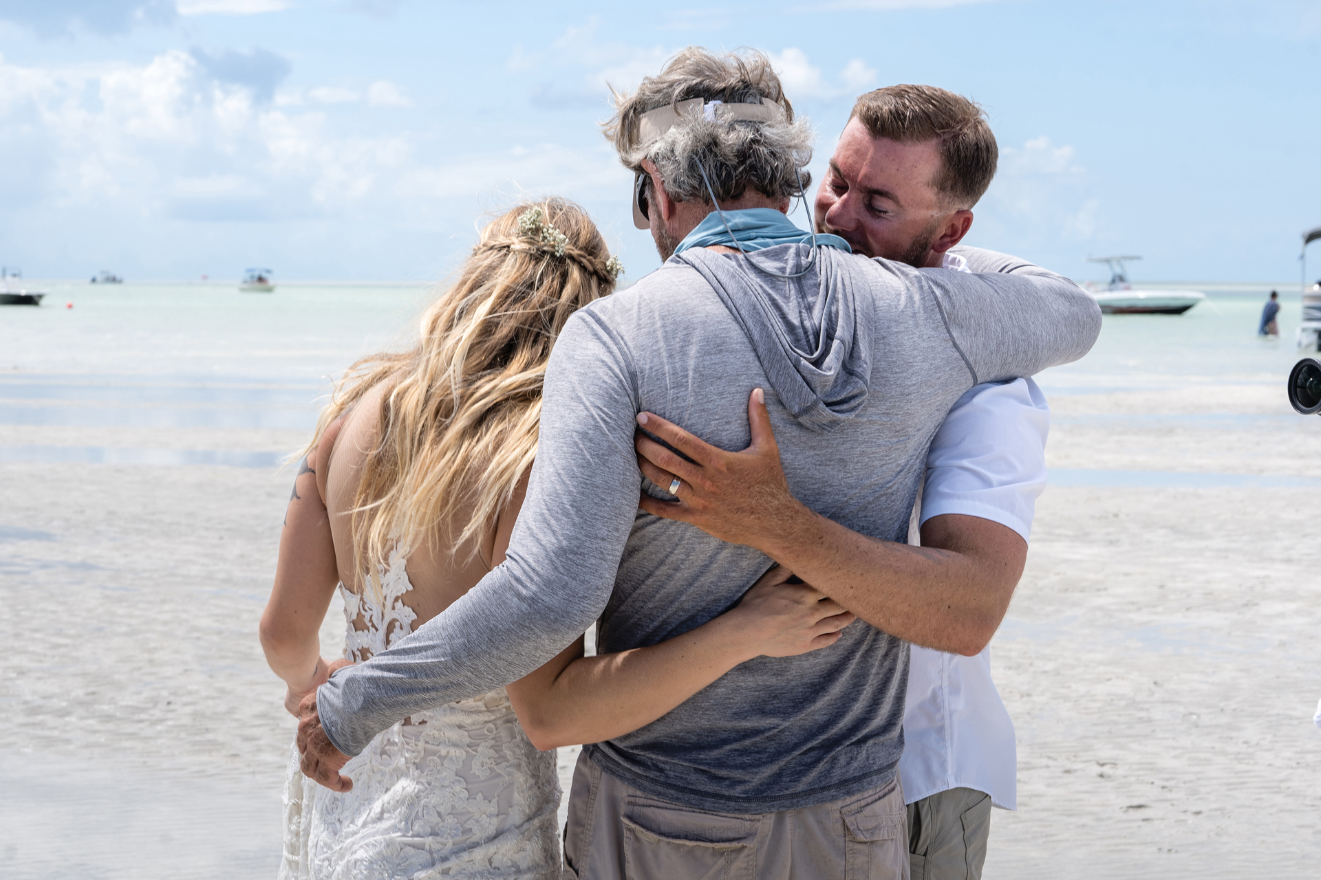 FL Keys Elopement Photographer - Key West Weddings | After the beach ceremony, the proud father of the groom congratulates the couple