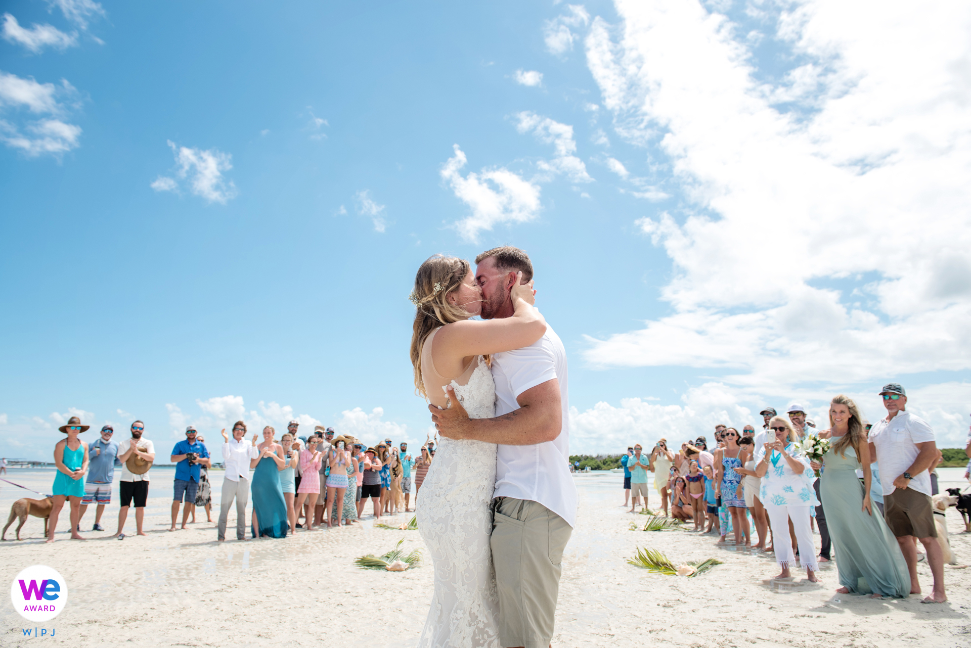 Marvin Key, Florida Keys Elopement Photographer | the bride and groom kissed to seal the deal in the bright sunshine