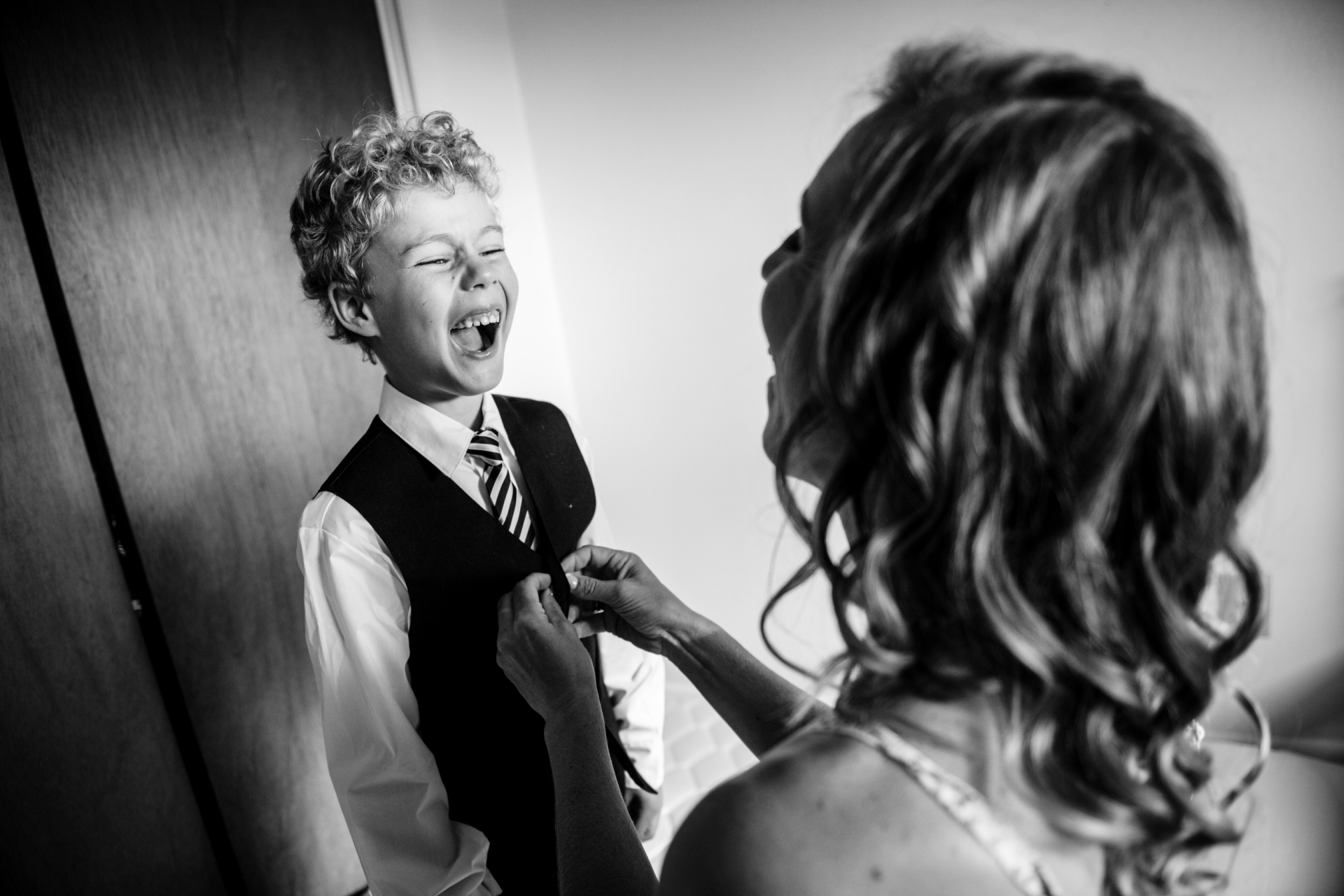 CO Micro Elopement Images | The bride helps her son get dressed for the wedding