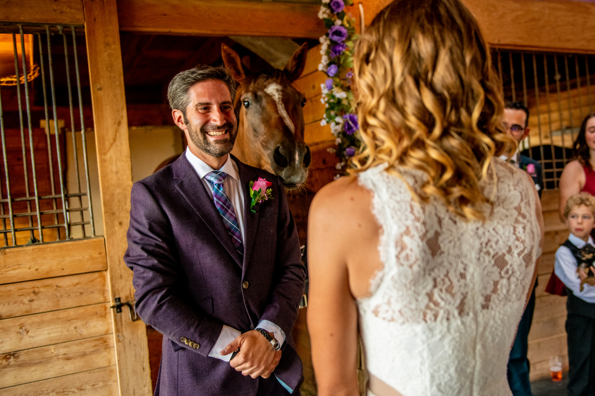 CO Micro Horse Farm Elopement | The bride and groom exchange vows in their horse barn
