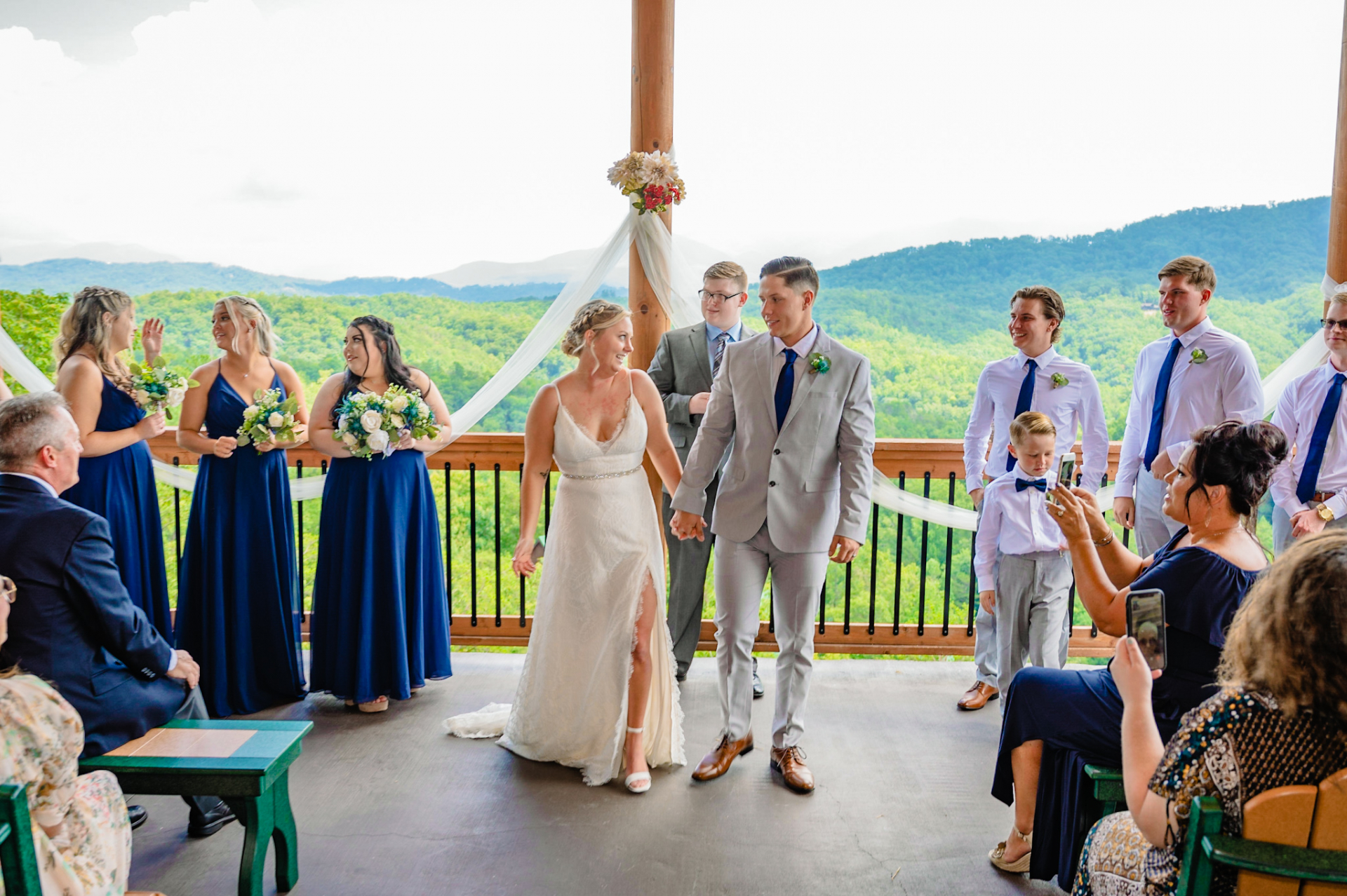 Timber Top Cabins, Pigeon Forge, TN Elopement Picture | The happy newlyweds look at each other and hold hands