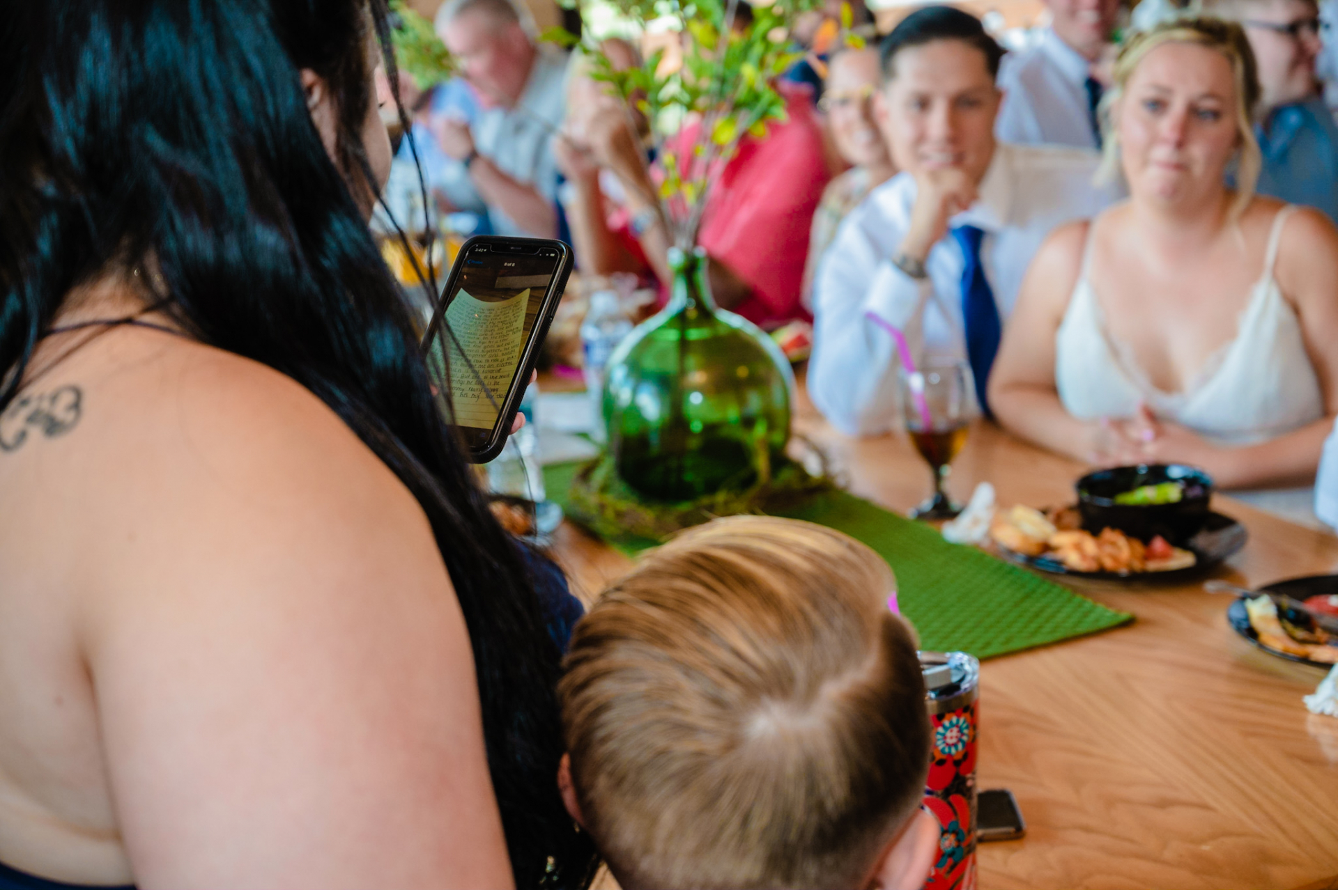 Gatlinburg Cabin Rentals - Pigeon Forge Elopement Photo | The bride and groom listen as the maid of honor reads from her phone