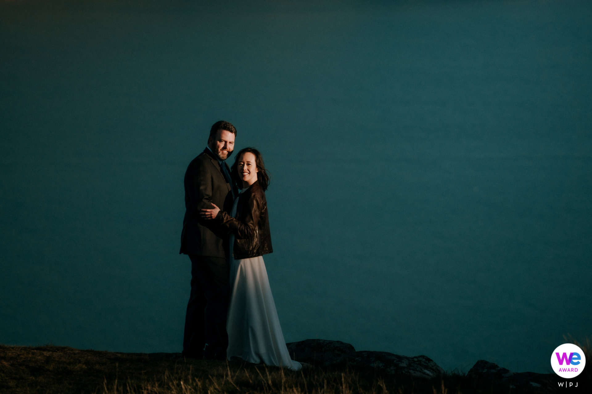 New Zealand Elopement Photographers | the couple posed together on top of the eroded remnants of the Lyttelton volcano