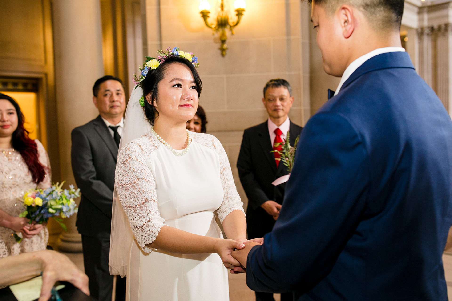 Wedding Photographers for San Francisco City Hall Elopements | During the ceremony, as the couple holds hands