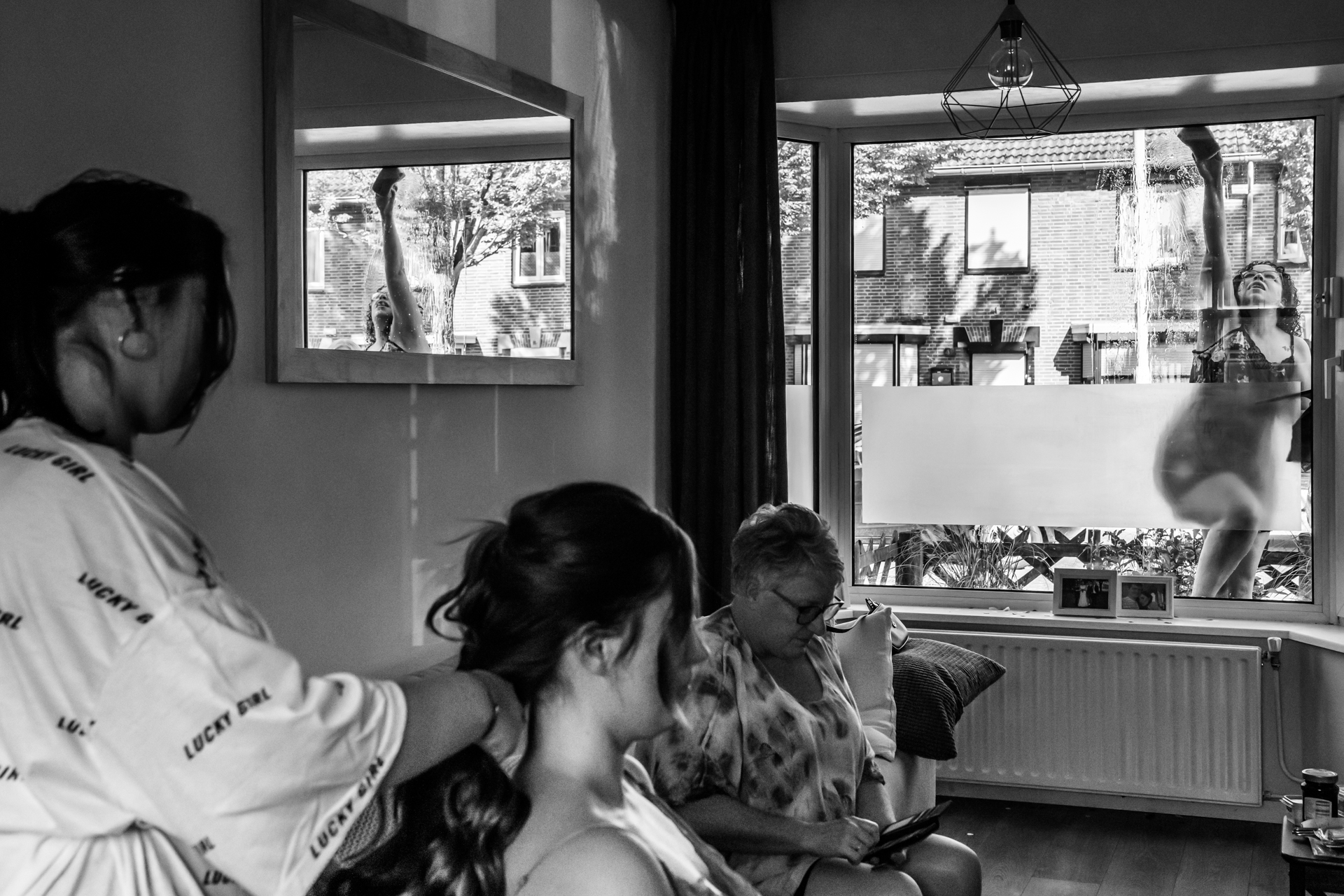 Elopement Photos from Breda City, Netherlands | The bride had forgotten to clean the window