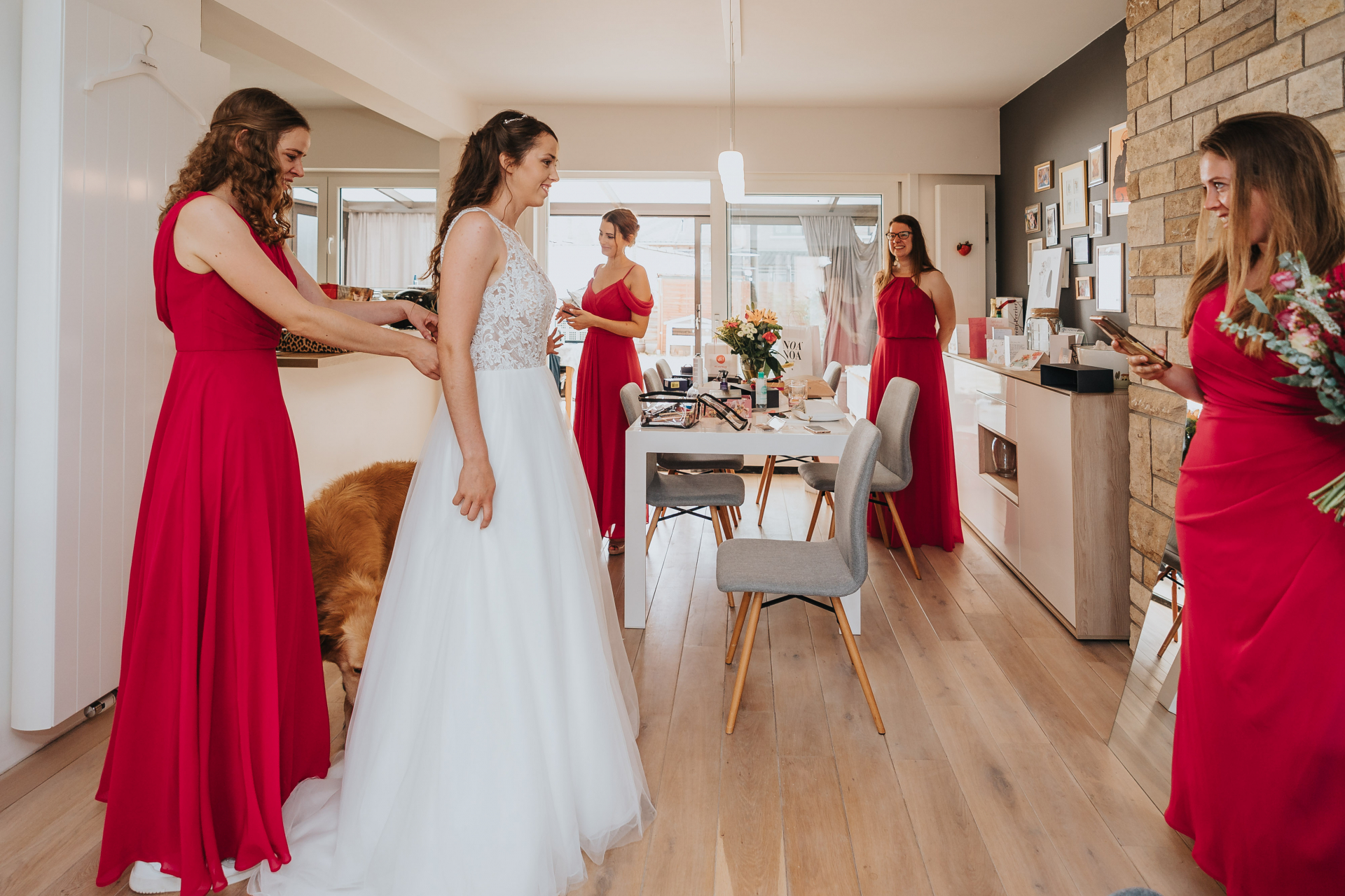 Brides Home Elopement Photography - Belgium COVID | The bride is getting dressed, assisted by her sister