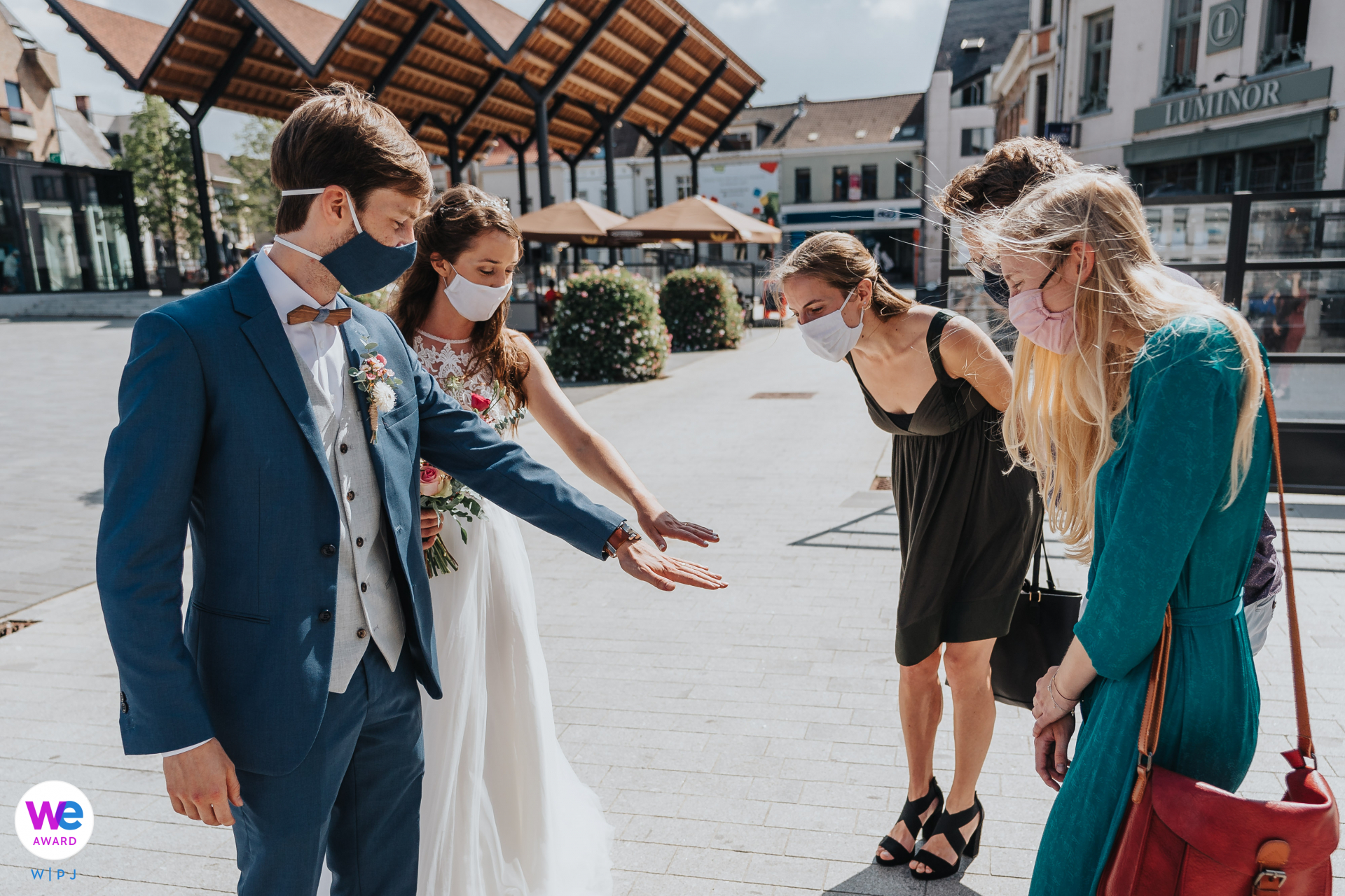 City Hall Vilvoorde, Belgium - COVID Elopement Image | The bride and groom show their rings