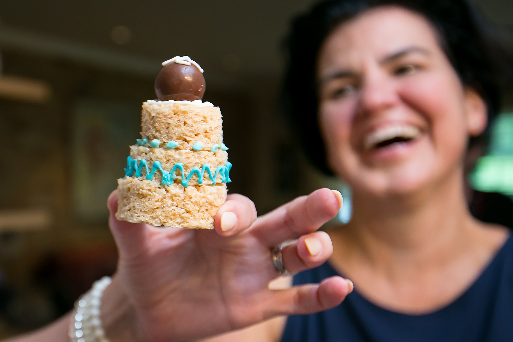 Small Backyard Wedding Photography | a tiny rice crispy cake made for them by a friend