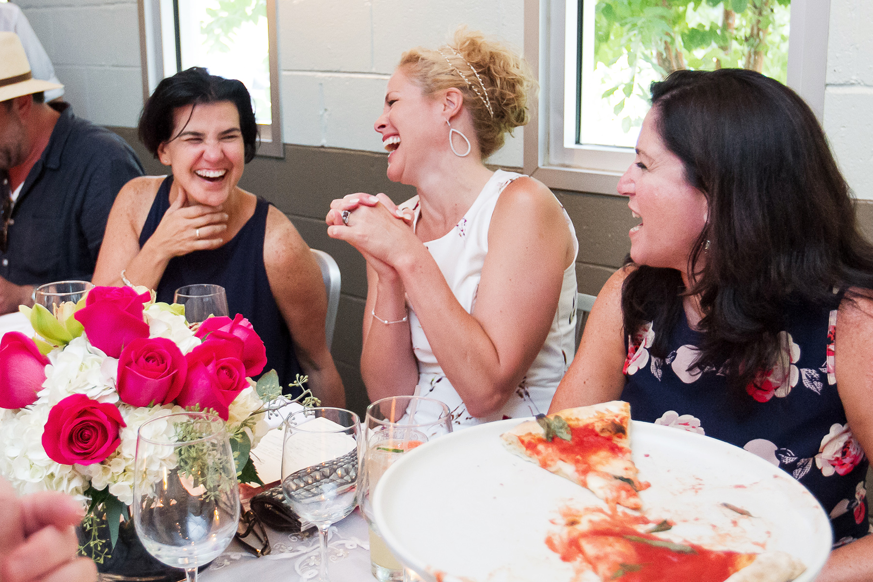 Floataway Cafe Restaurant Elopement Venue - Atlanta, GA | The maid of honor shares a laugh during dinner