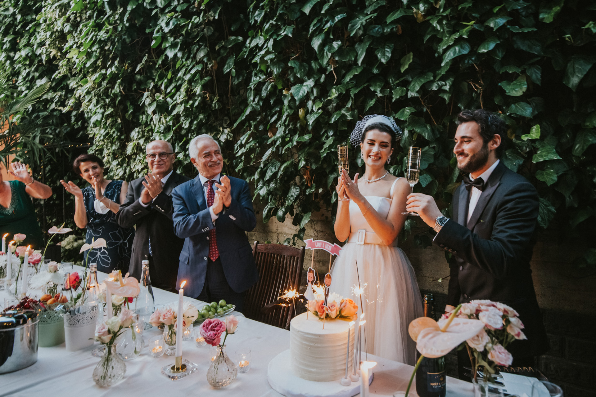 Elopement Ceremony Photographers in Istanbul | The bride and the couple's family members all share a cheerful moment