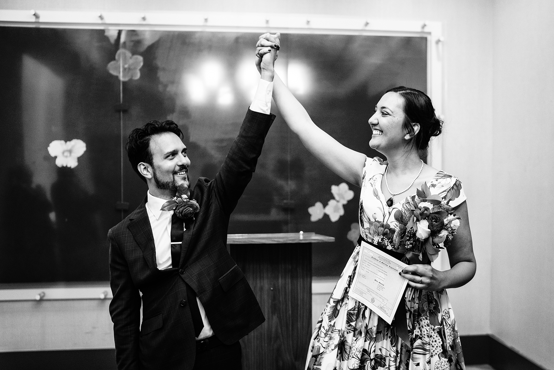City Hall Elopement Photographer for NY | Ready to conquer the world together, the couple celebrates their marriage