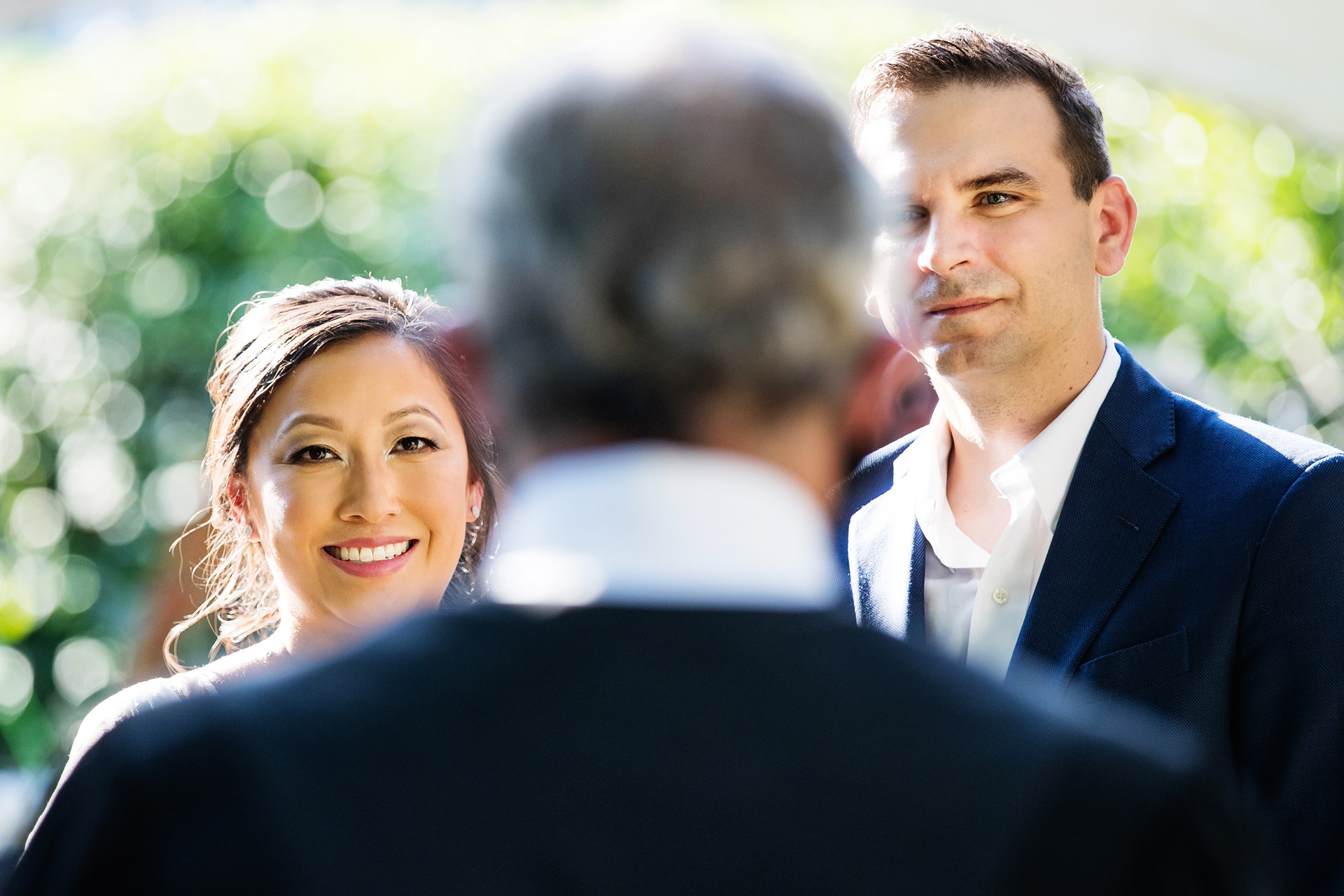 Elope in New Jersey and The Jersey Shore | The couple listens to the Judge during the backyard wedding ceremony