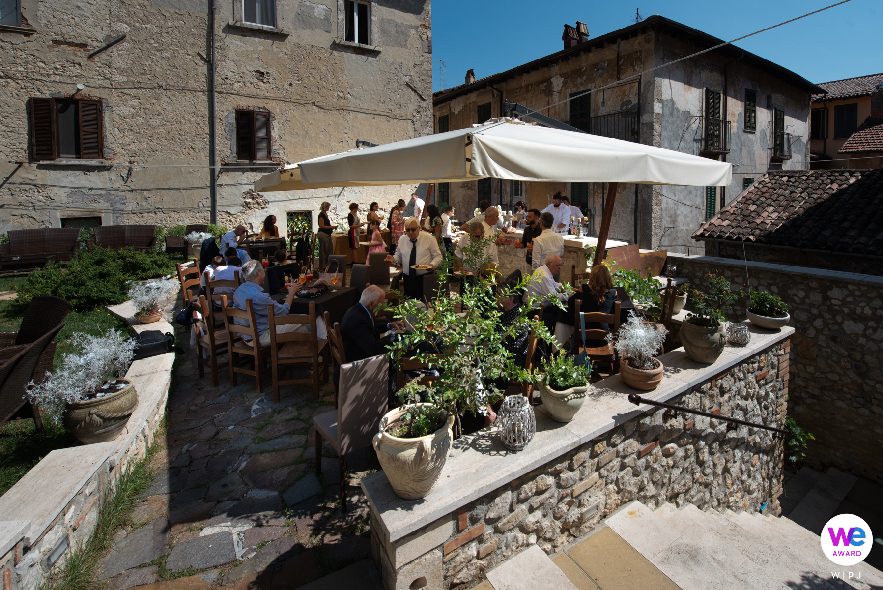 Municipality of Tagliacozzo - GIARDINO RESTA Restaurant Elopement Venue Image | The bride and groom have just opened the reception and meet with their guests on the terrace