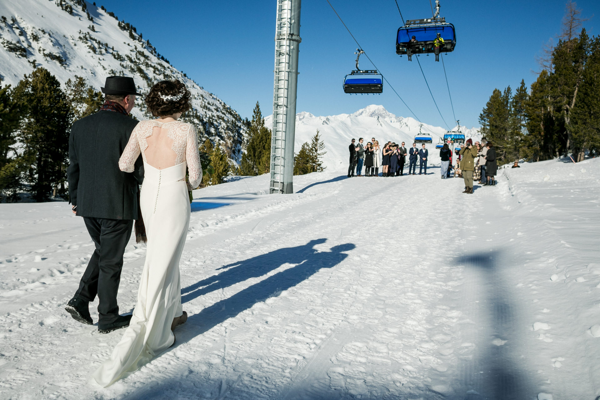 Marriage Photo from the Snow - Getting Married at a France Resort | The bride, in a flowing dress with lace accents