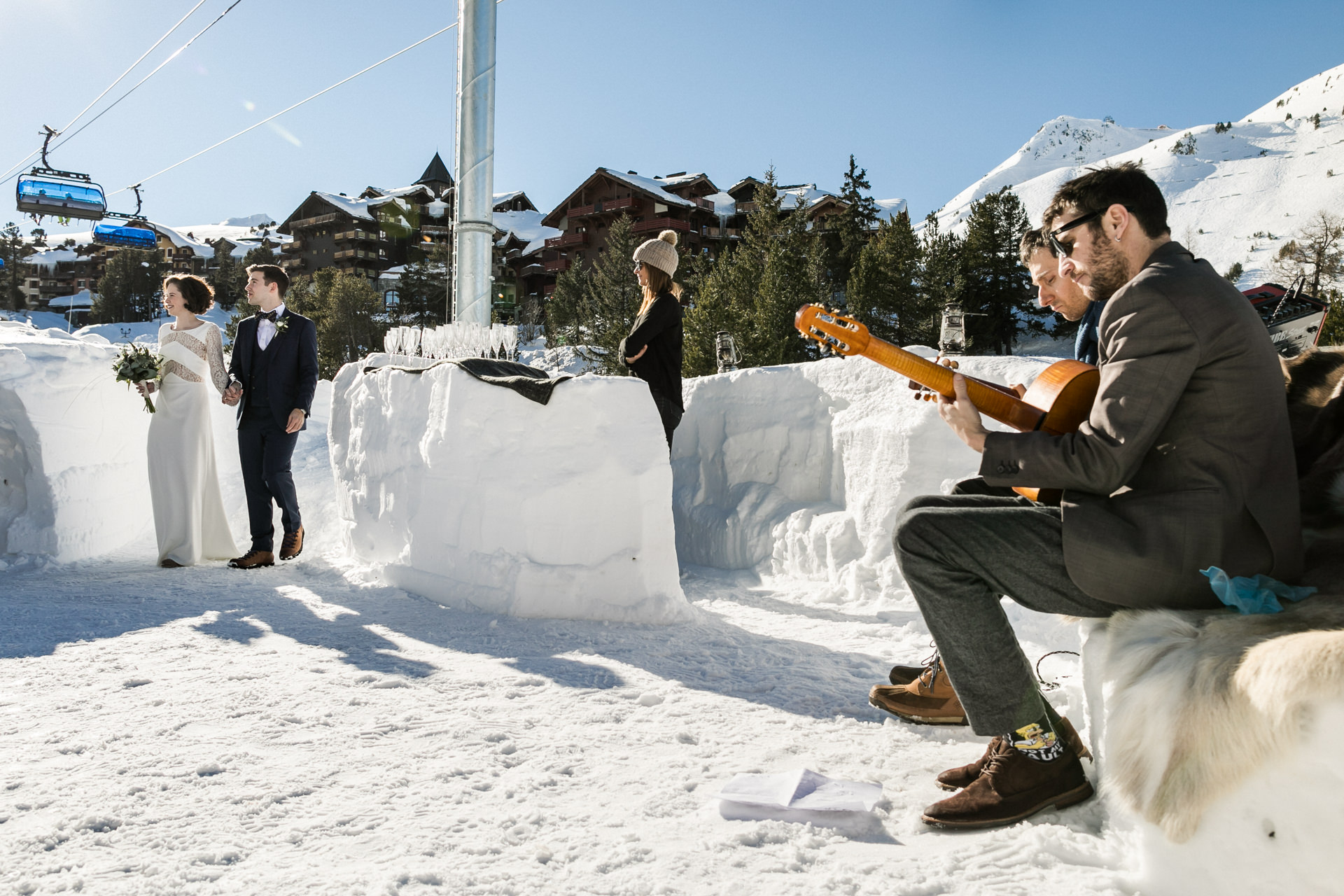 Alpine-style Ski Chalet Elopement Ceremony Photography | The bride and groom begin the ceremony at the top of the mountain