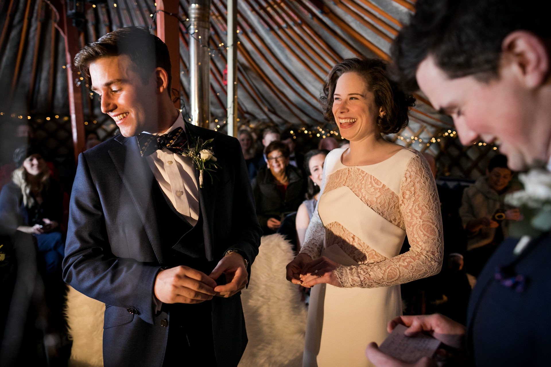 Les Arcs, France Elopement Photography | The bride smiles with delight as the groom looks for the wedding ring