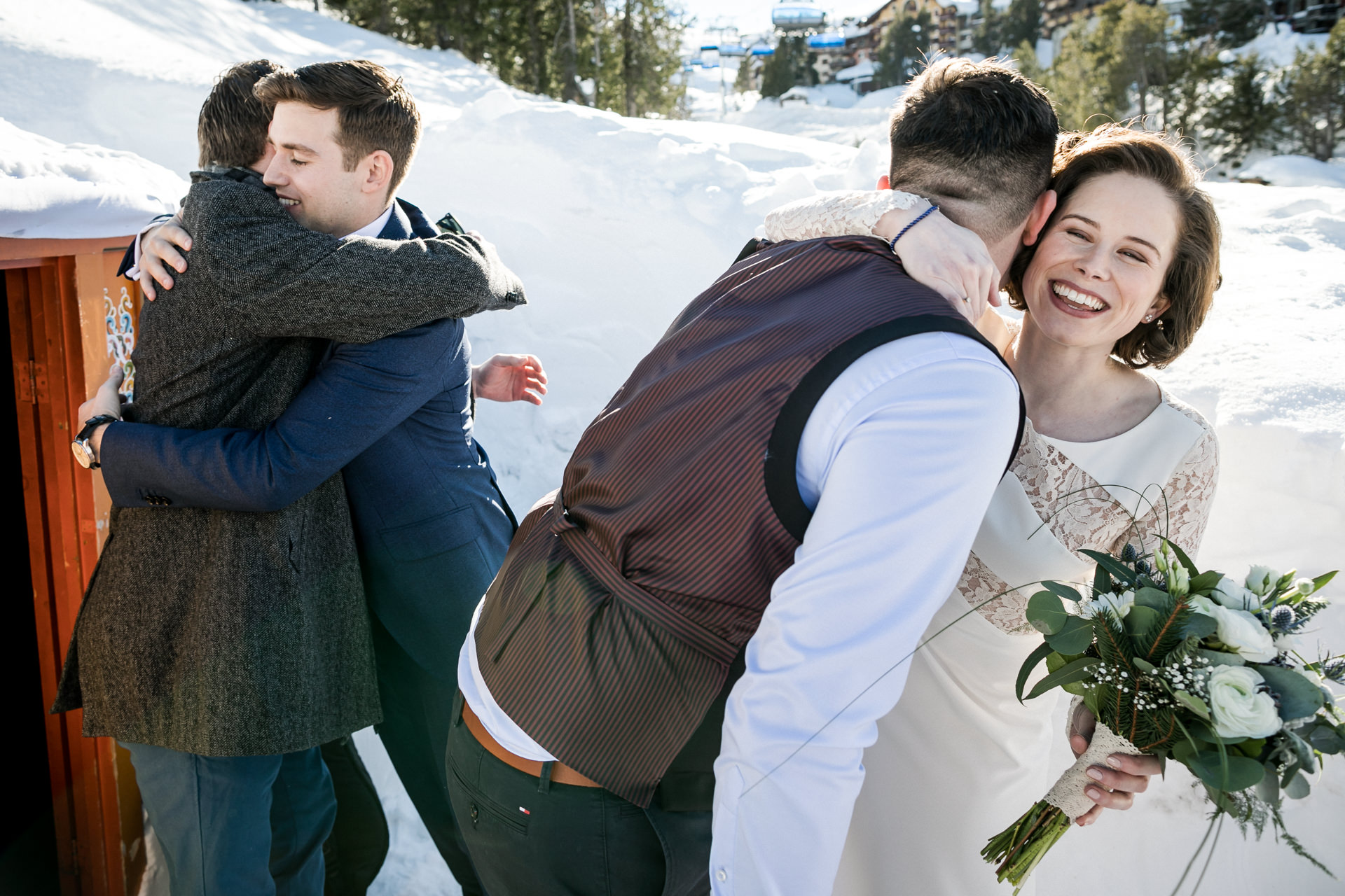 France Elopement Picture from Les Arcs Ski Resort | The bride and groom hug their friends