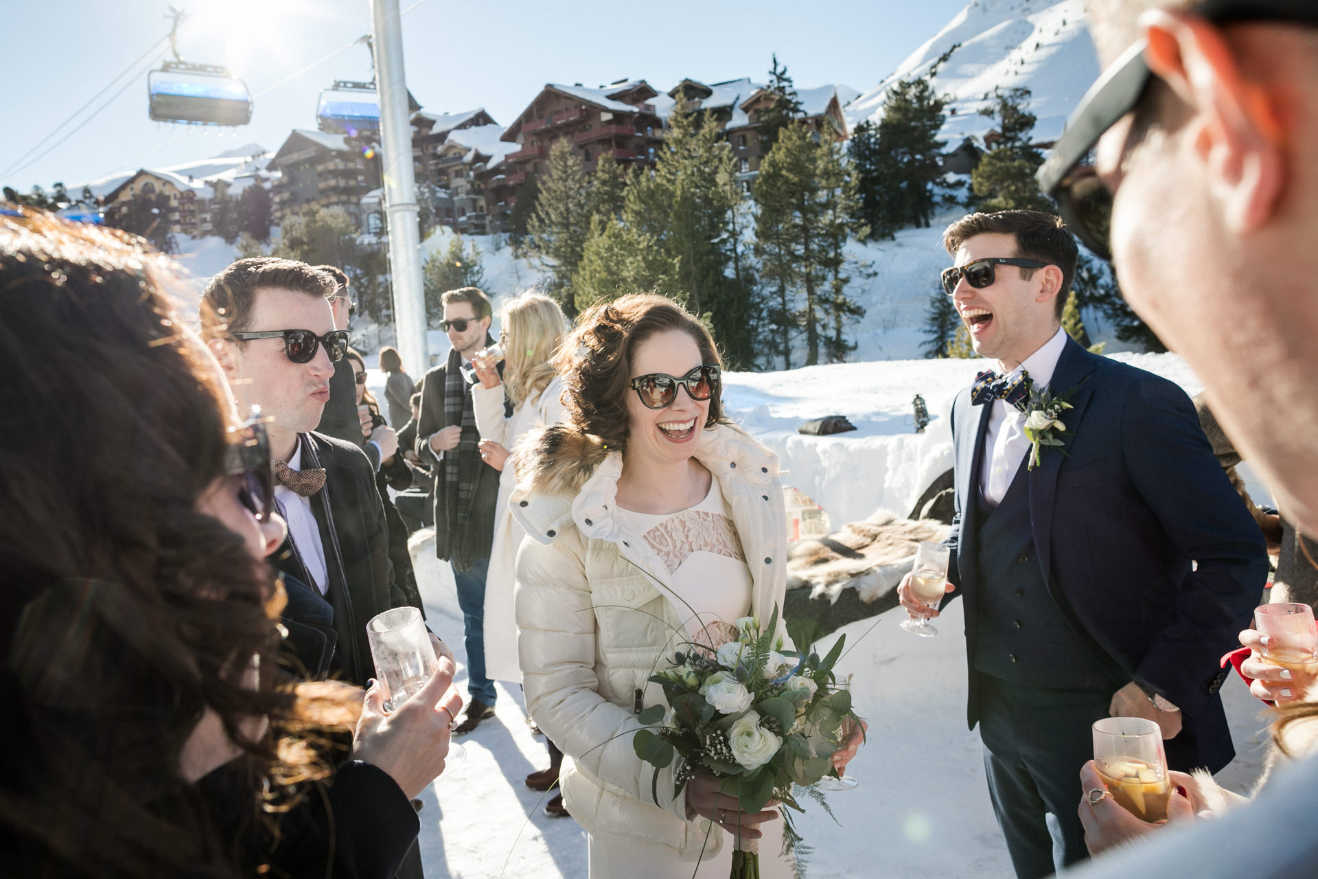 France Mountain Winter Elopement in the Snow | a coordinating ski coat to her wedding day ensemble