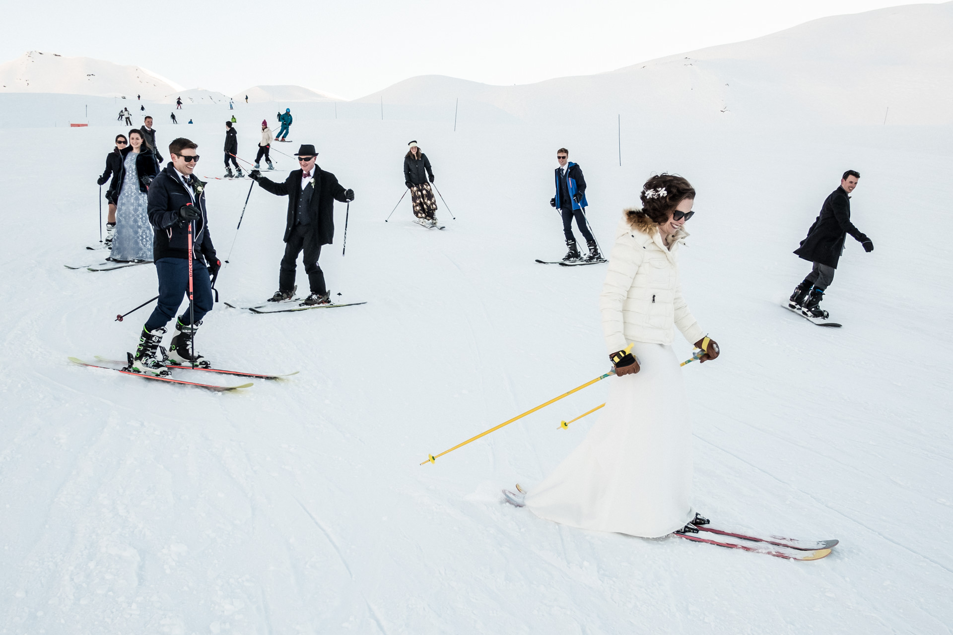 Les Arcs, France Ski Elopement Bride Image | The bride and groom finish off their celebration by skiing down the slopes