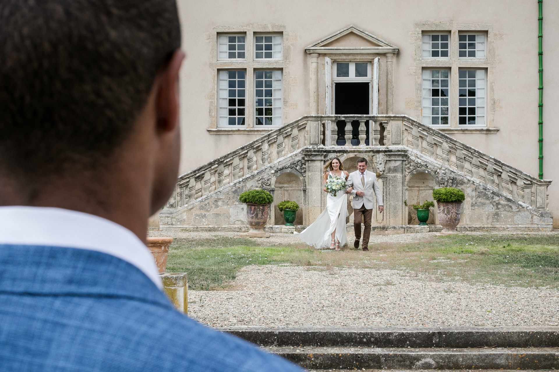 Pézenas, France Elopement Photography | The groom watches as his bride
