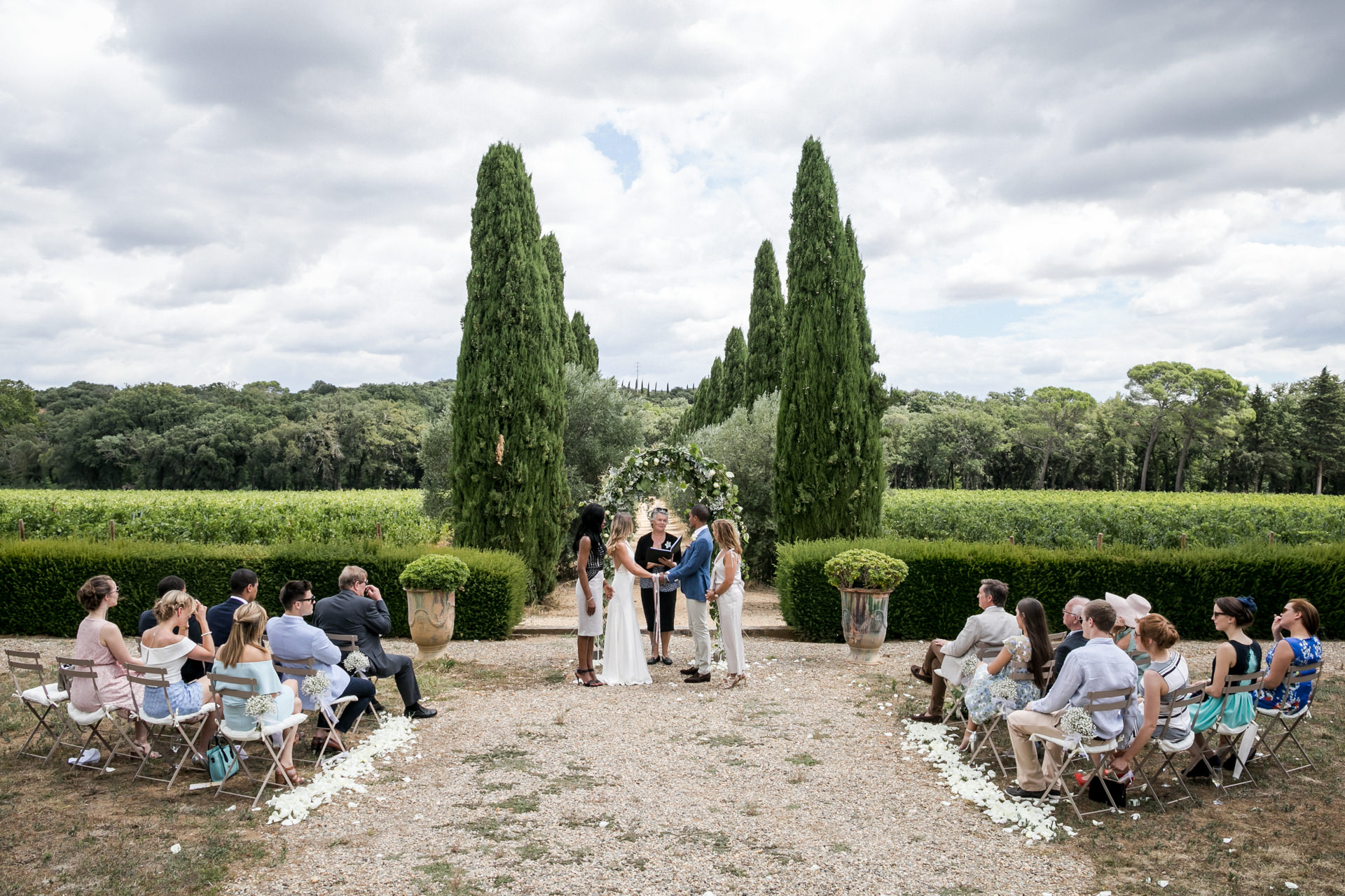 France vineyard elopement estate venue photography | A small group of close family members and friends watch the ceremony