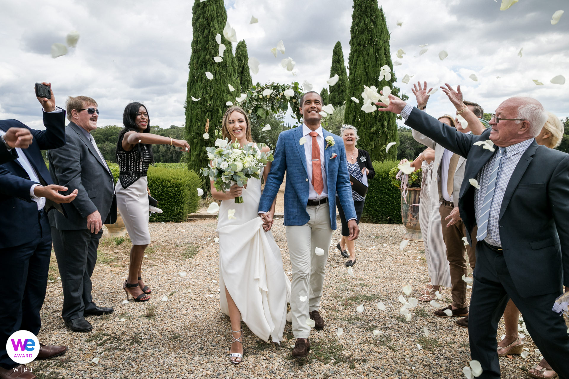 Seigneurie de Peyrat, France Elopement Photographer | The guests toss rose petals at the bride and groom
