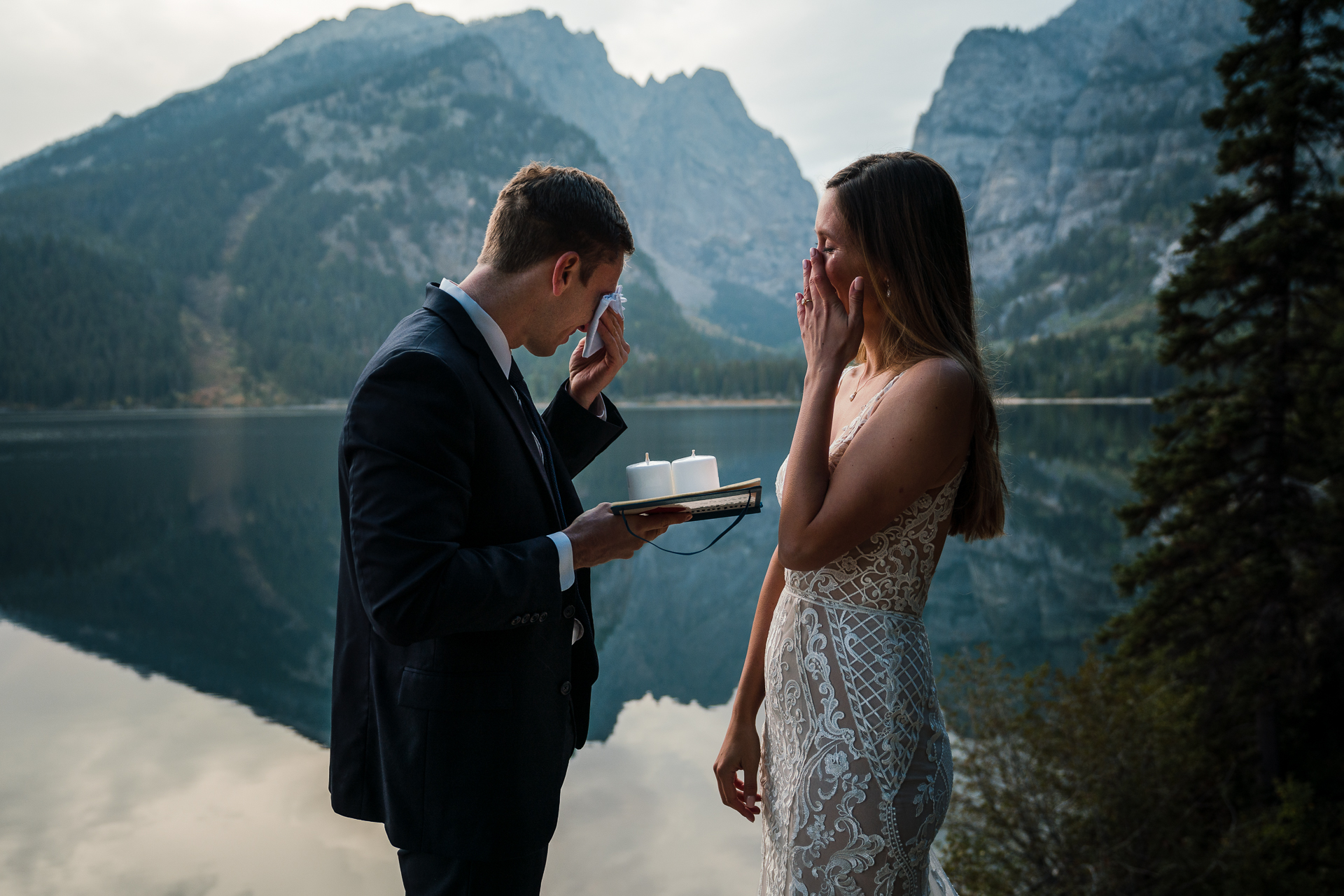 Grand Teton National Park Adventure Elopement Photographer | The couple wiping away tears during their vows