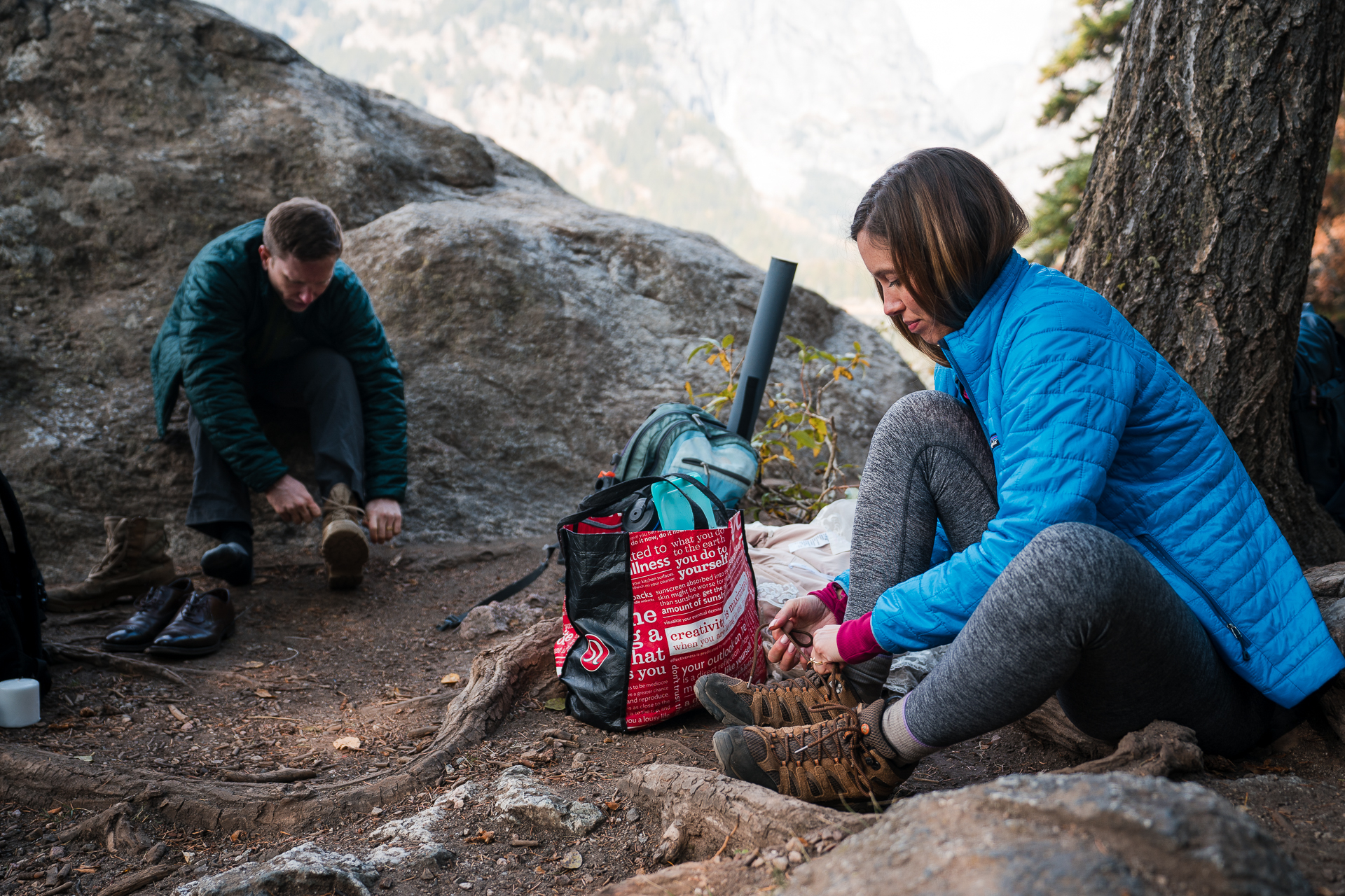 Grand Teton National Park Intimate Elopement Picture | The couple changing out of their wedding attire to start hiking out