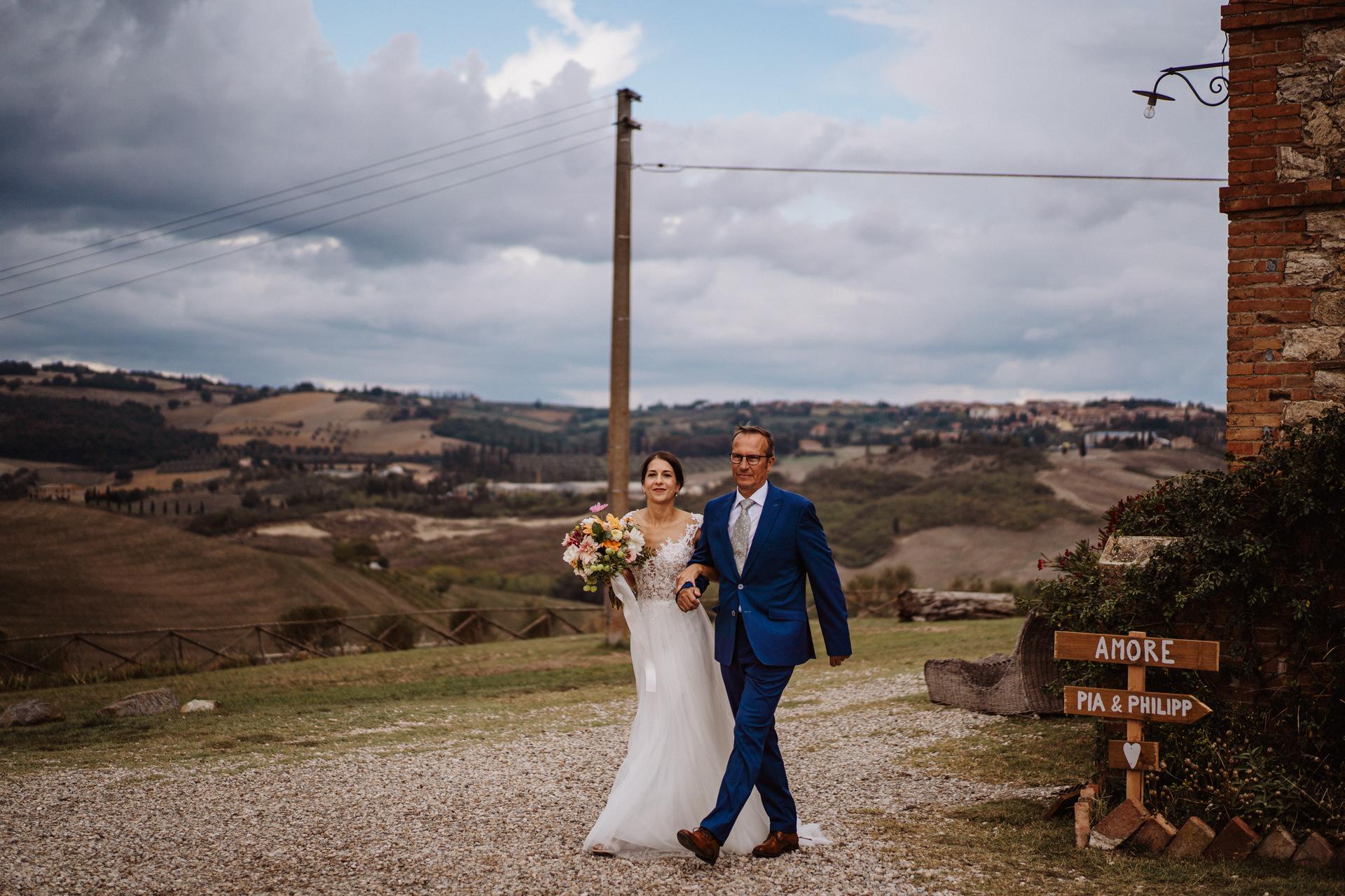 Il Rigo Elopement Picture of Agriturismo Il Rigo Bride   The bride is escorted by her father to the ceremony