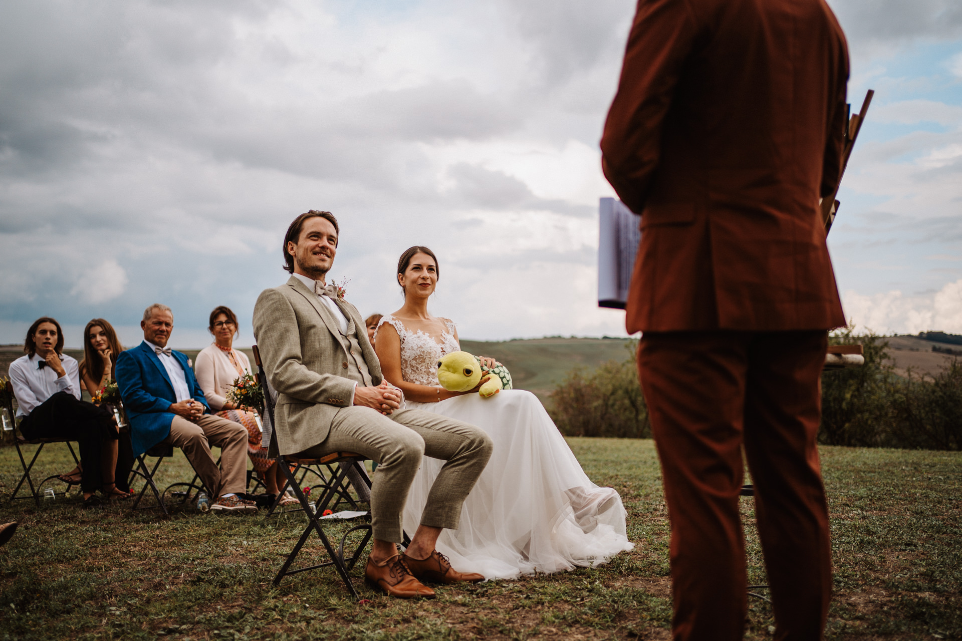 Agriturismo IL Rigo Elopement Photos - Tuscany, IT   The couple sits during the outdoor ceremony