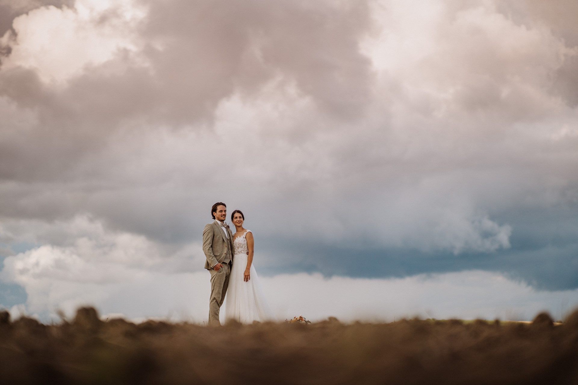 Agriturismo il Rigo Bride and Groom Elopement Portrait   The sky with the colors of the storm can be seen in the background