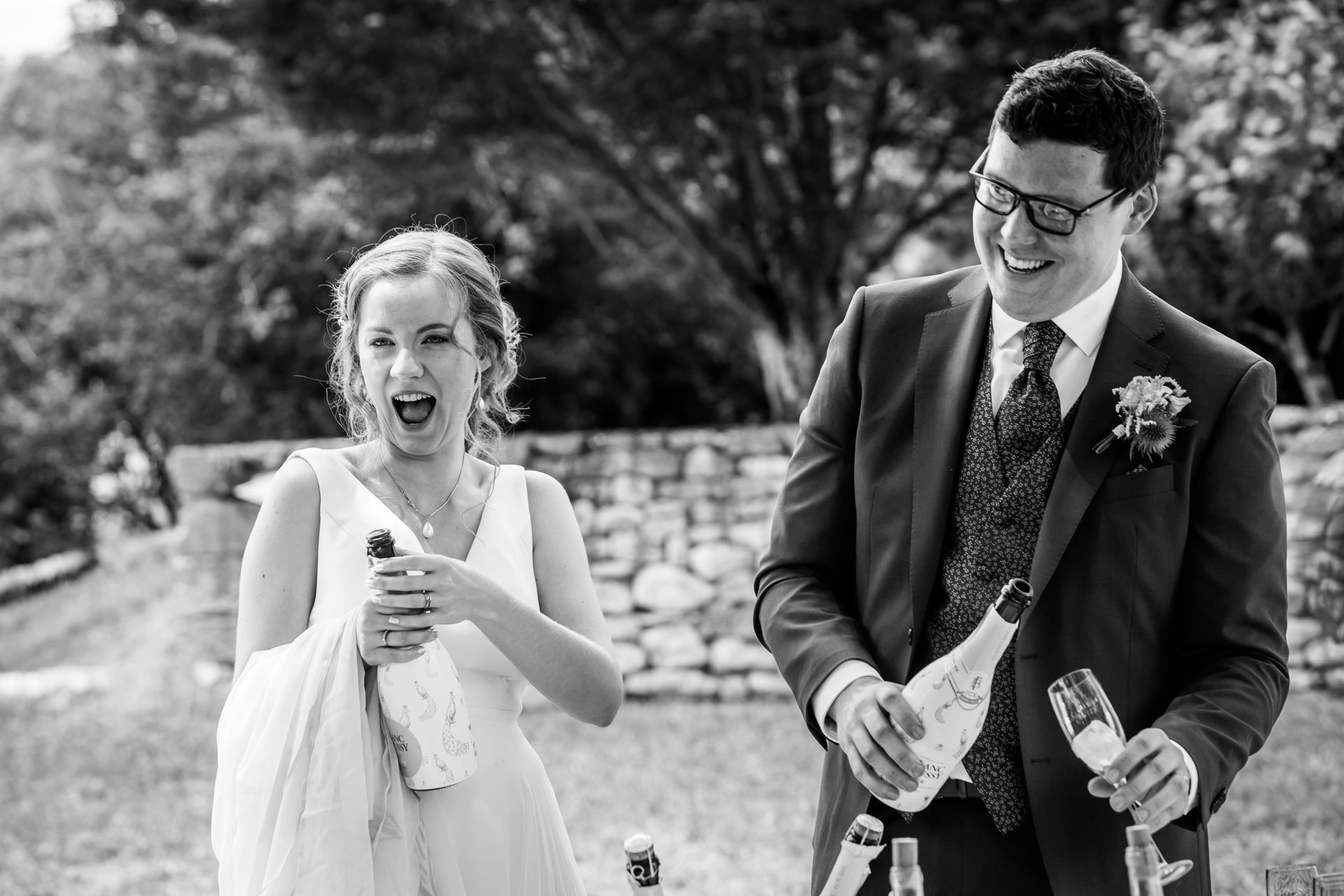 Albi Elopements in France - Photography | The bride pops open a bottle of champagne